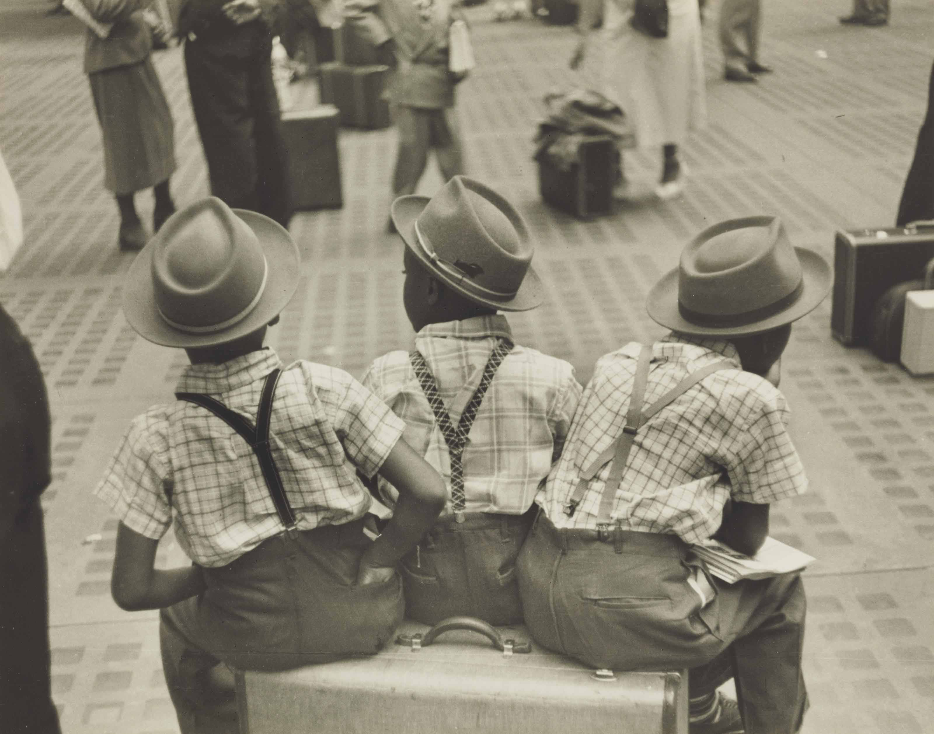 Three little boys on suitcase, Penn Station, c. 1947