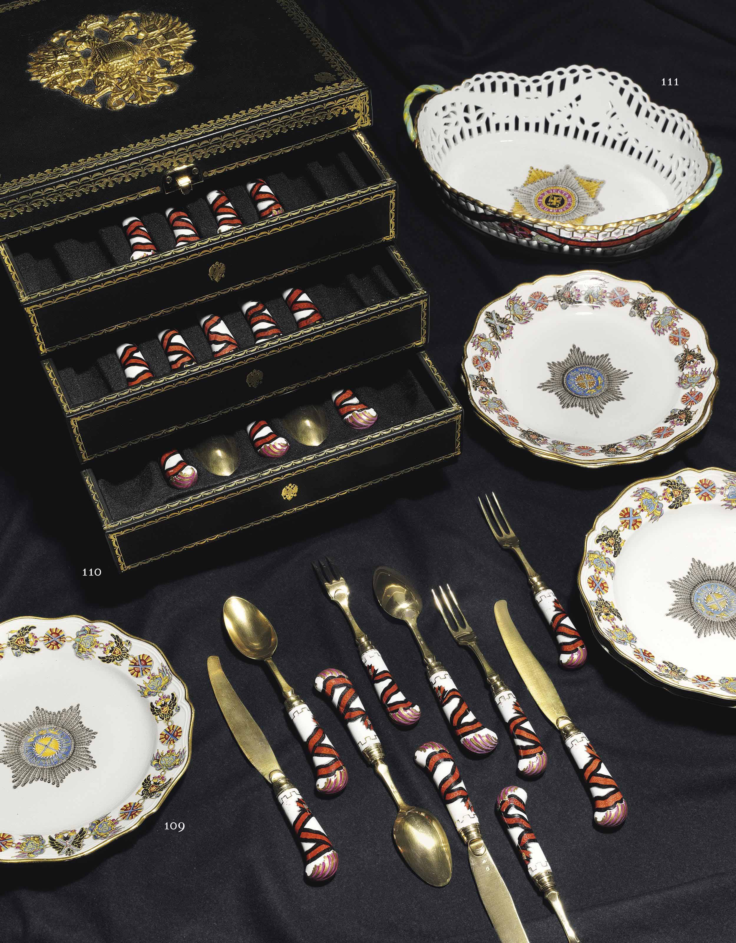 A SILVER-GILT MOUNTED PORCELAIN FRUIT SET FROM THE SERVICE OF THE ORDER OF ST. VLADIMIR