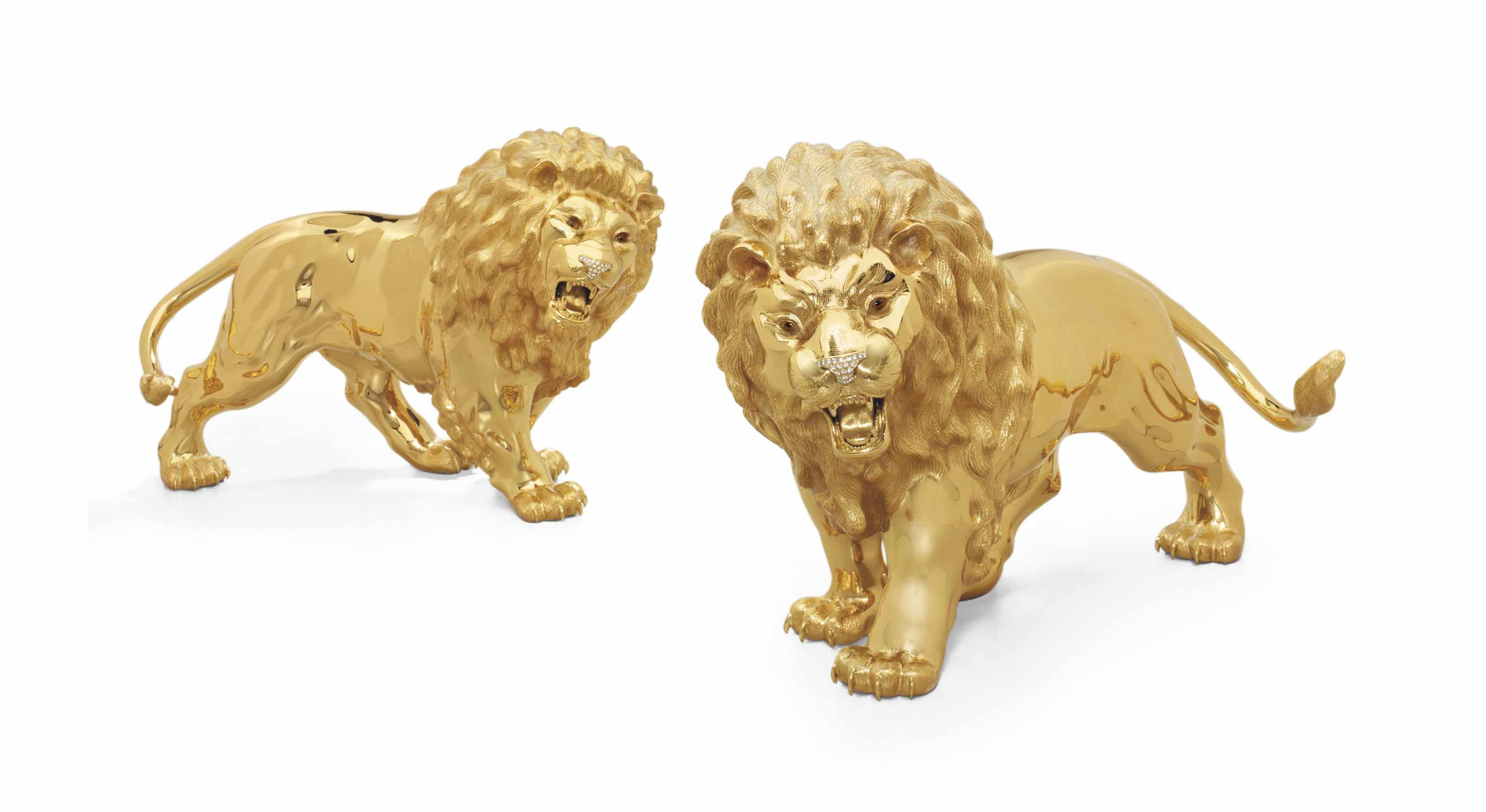 A PAIR OF LARGE SILVER-GILT AND GEM-SET LIONS
