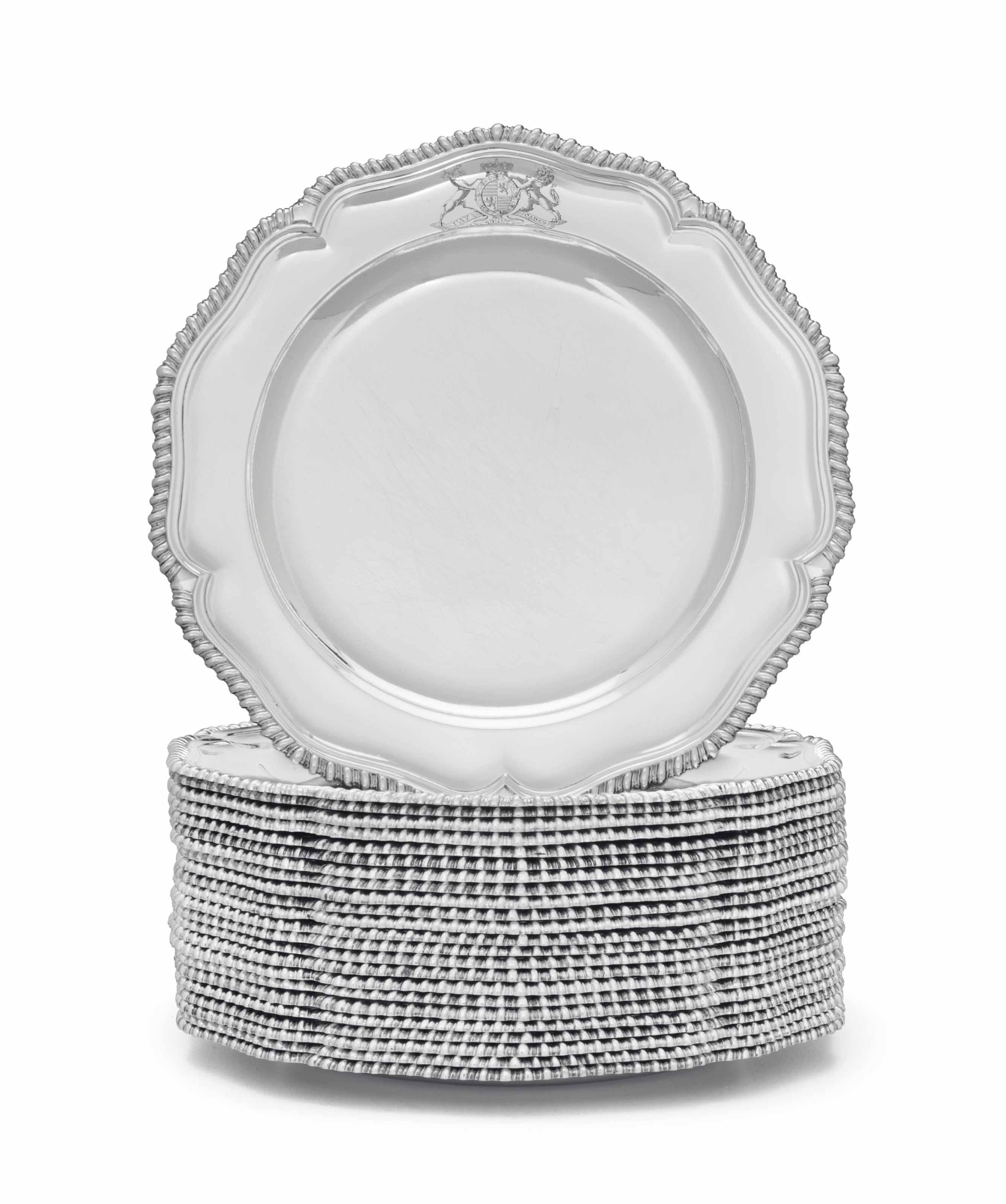 A SET OF TWENTY-FOUR GEORGE III SILVER DINNER PLATES