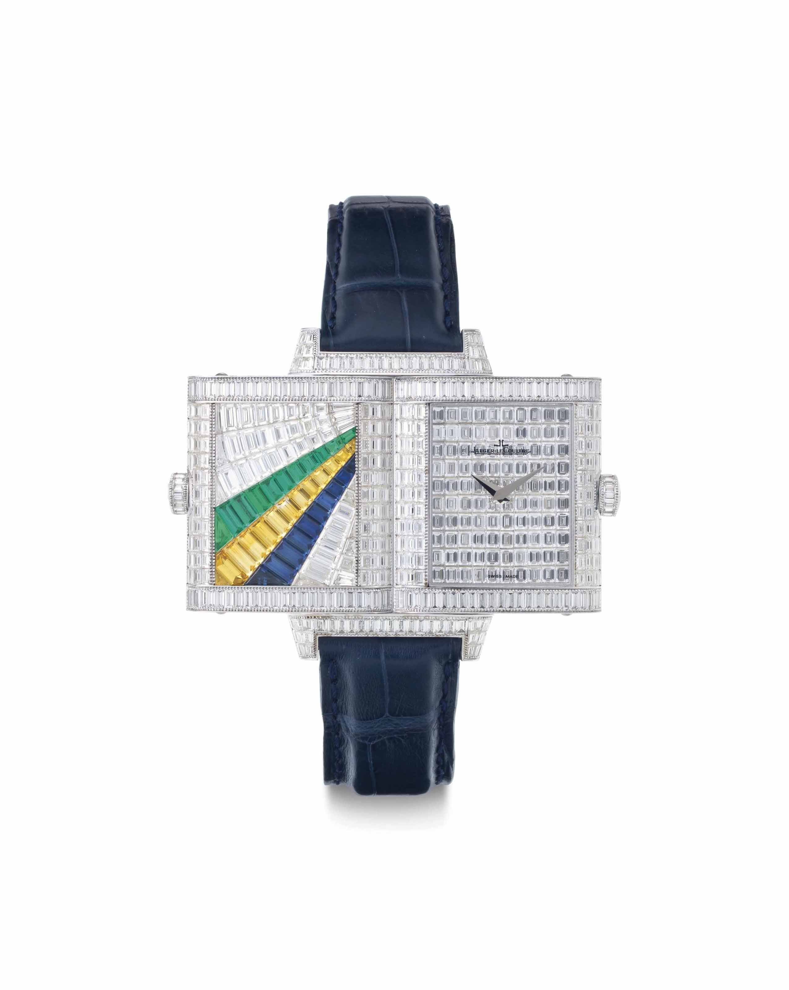 Jaeger-LeCoultre. A Fine and Possibly Unique 18k White Gold and Diamond, Sapphire, and Emerald-Set Reversible Wristwatch