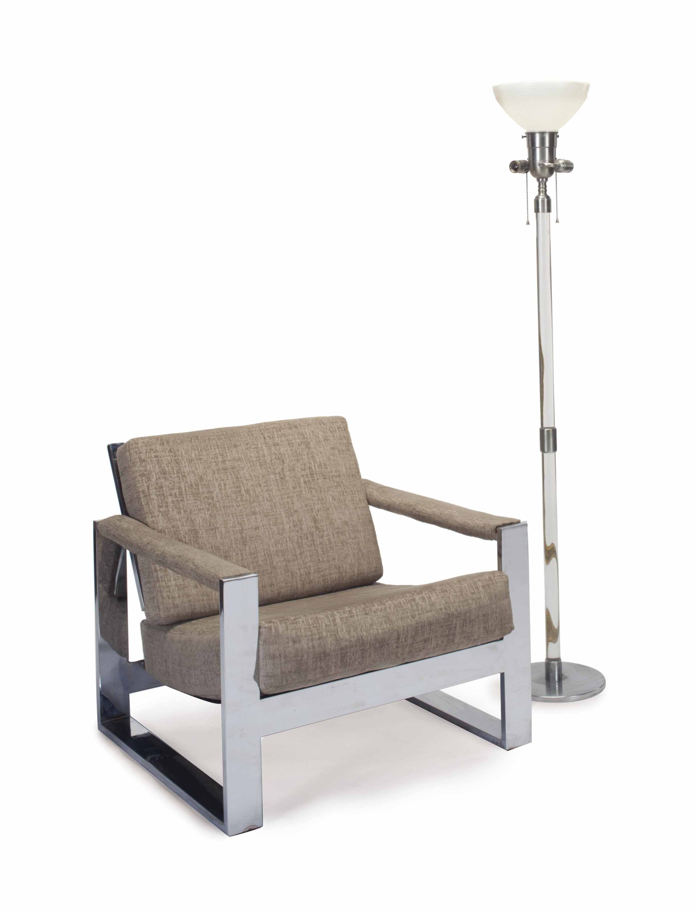 A CHROMED METAL AND UPHOLSTERED EASY CHAIR, AND A STEEL AND COLORLESS GLASS FLOOR LAMP,