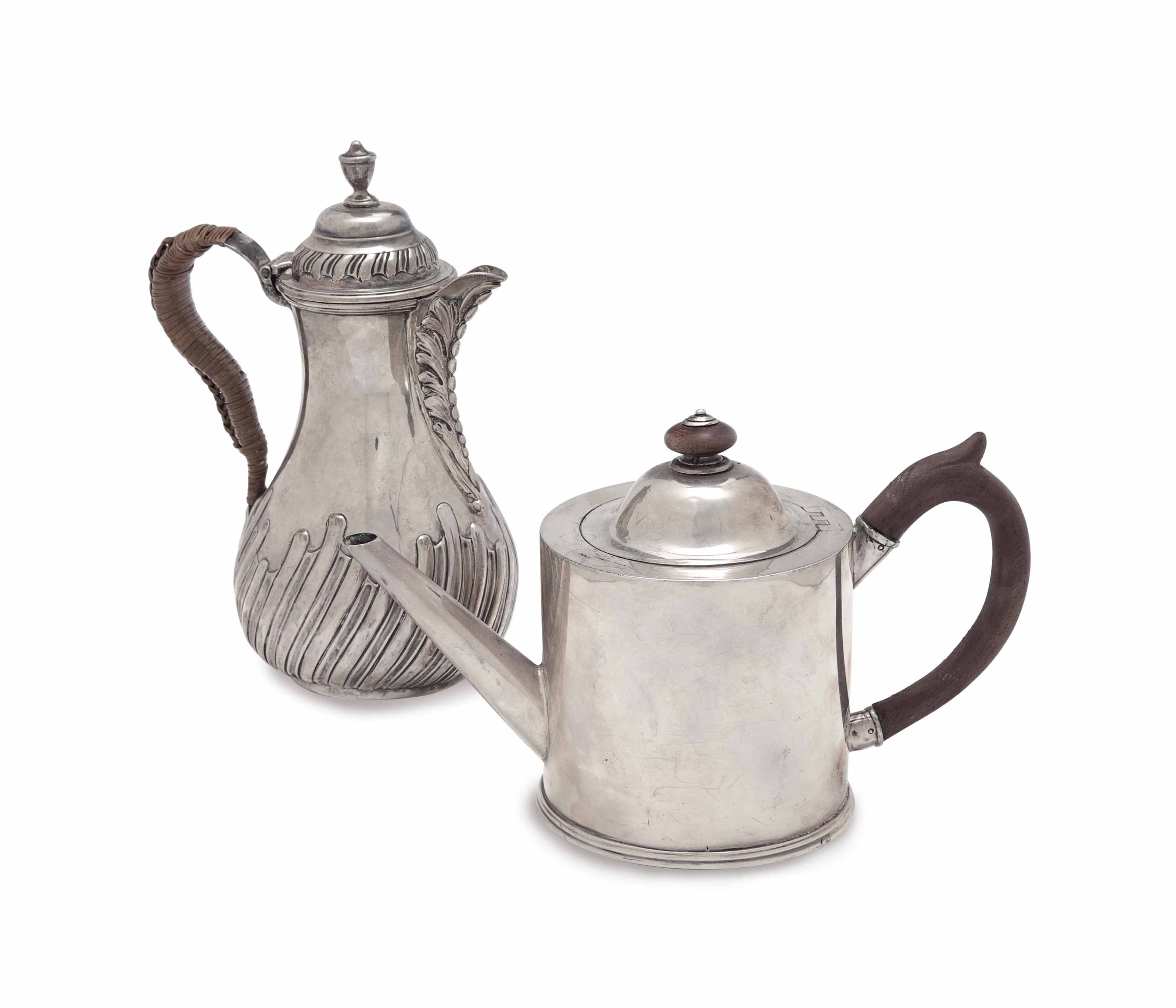A GEORGE III SILVER HOT WATER JUG, AND A DRUM-FORM TEAPOT,