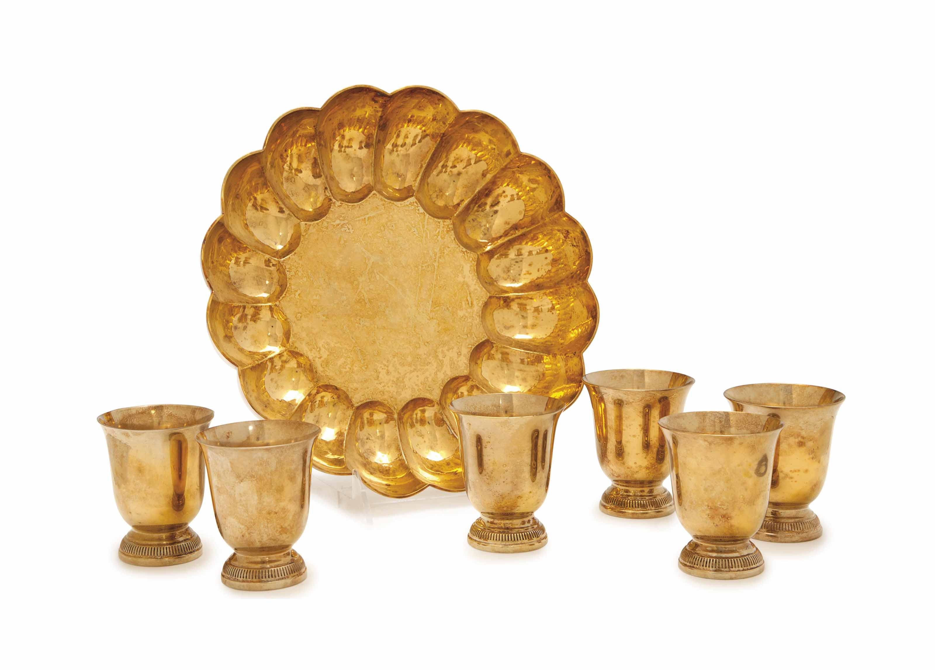AN ENGLISH SILVER-GILT SCALLOPED CENTERBOWL, A SET OF EIGHT FRENCH GILT-PLATE BEAKERS,