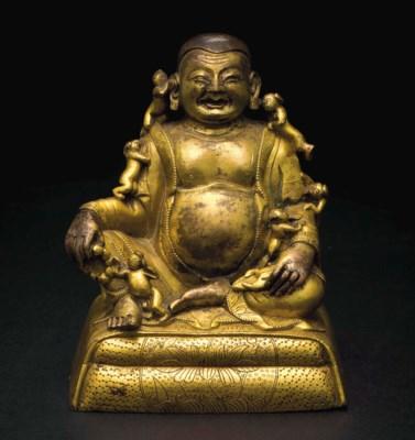 A gilt bronze figure of Budai