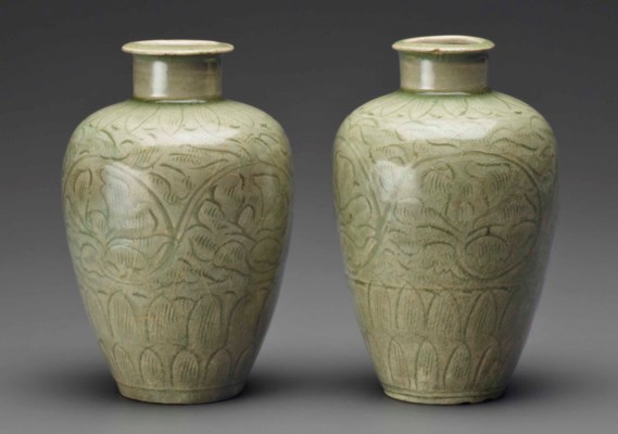 A PAIR OF EARLY CELADON CARVED