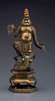 A GILT-BRONZE FIGURE OF A FORE