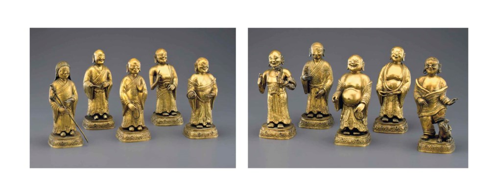 A SET OF TEN GILDED REPOUSSE C