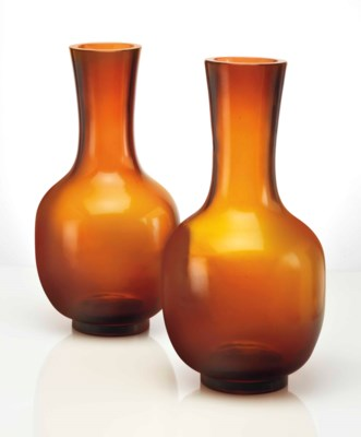 A PAIR OF AMBER GLASS VASES