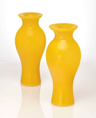 A PAIR OF OPAQUE YELLOW GLASS