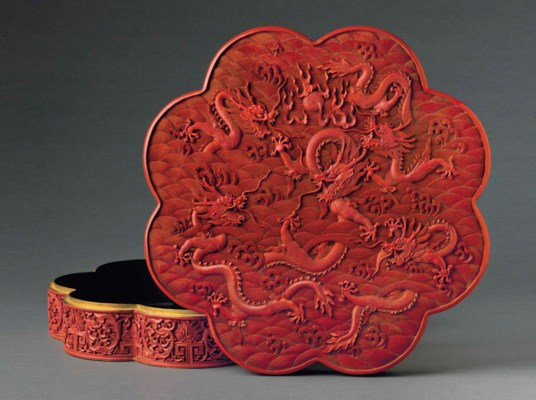 A CARVED RED LACQUER OCTALOBED