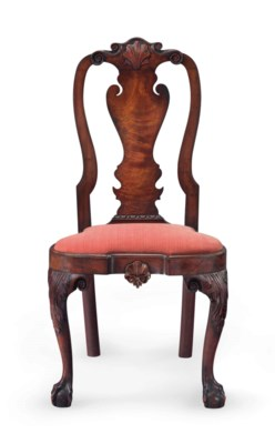 A QUEEN ANNE CARVED WALNUT COM