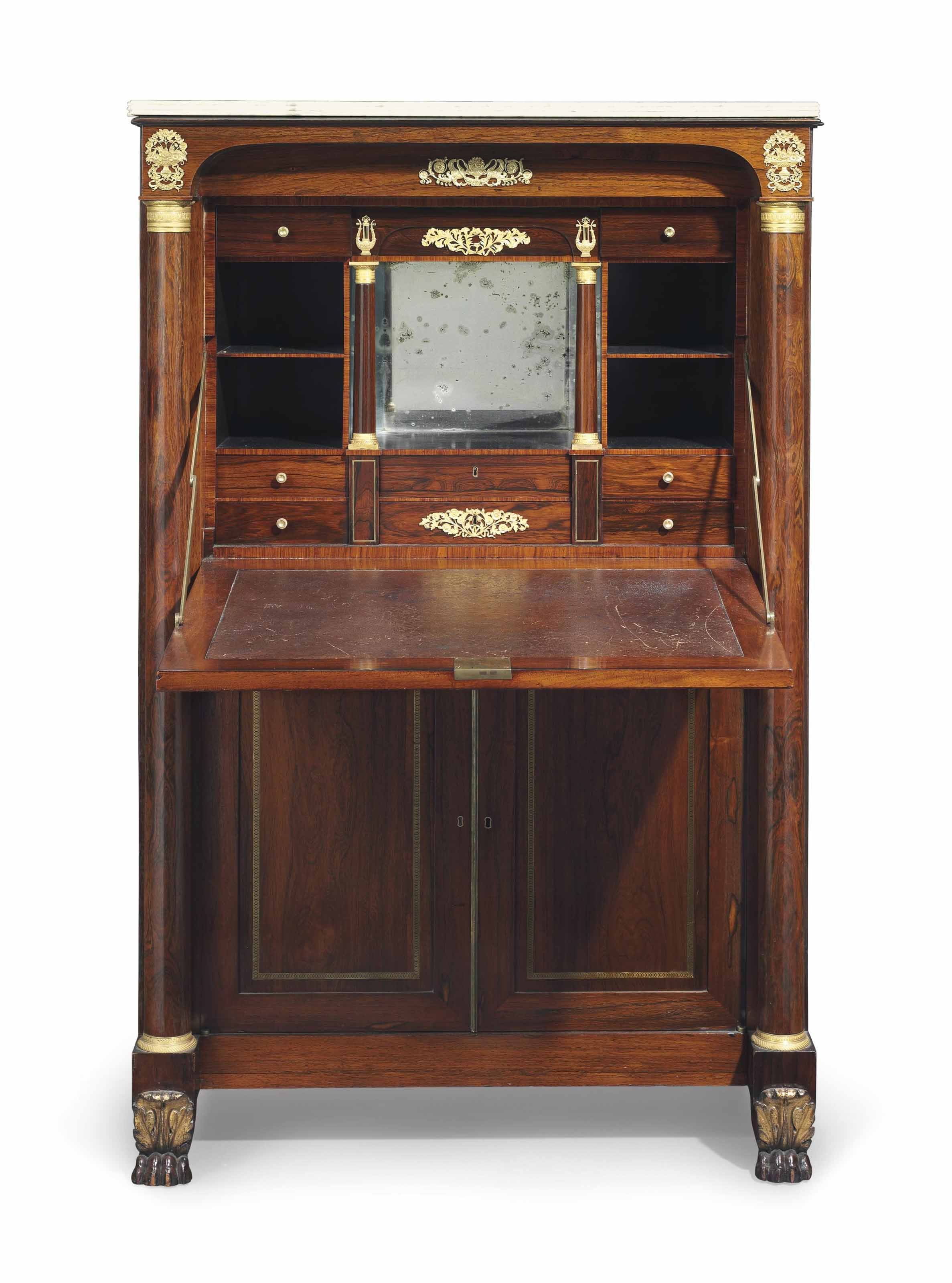 A CLASSICAL PARCEL-GILT, ORMOLU-MOUNTED AND BRASS-INLAID ROSEWOOD MARBLE-TOP SECRETAIRE A ABATTANT