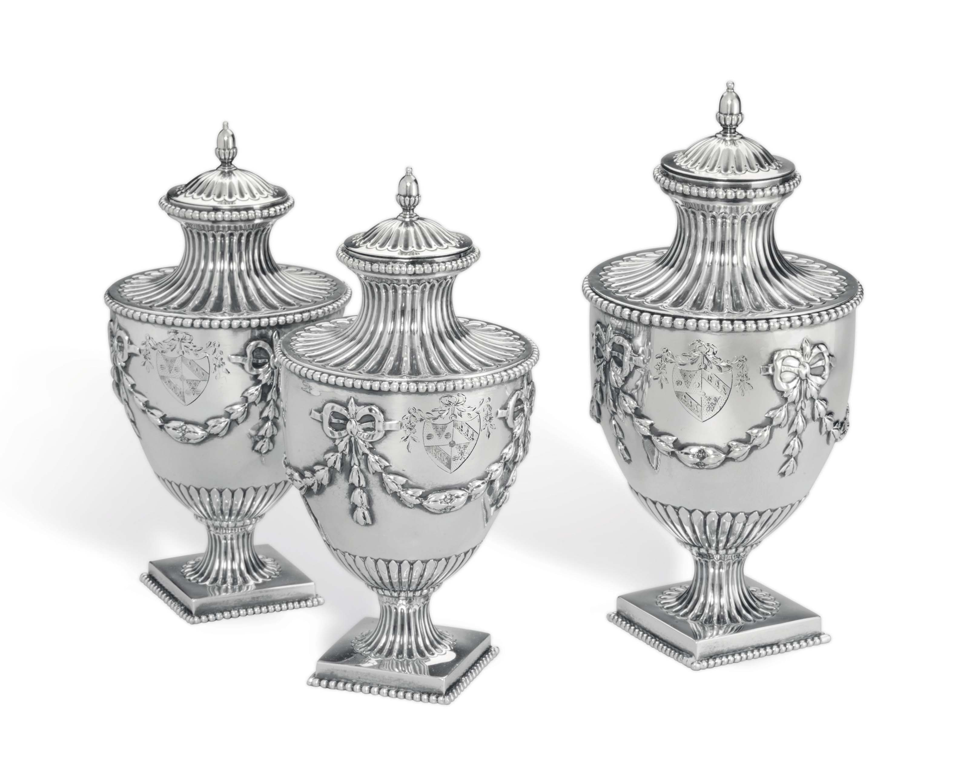 A SET OF THREE GEORGE III SILVER CONDIMENT VASES