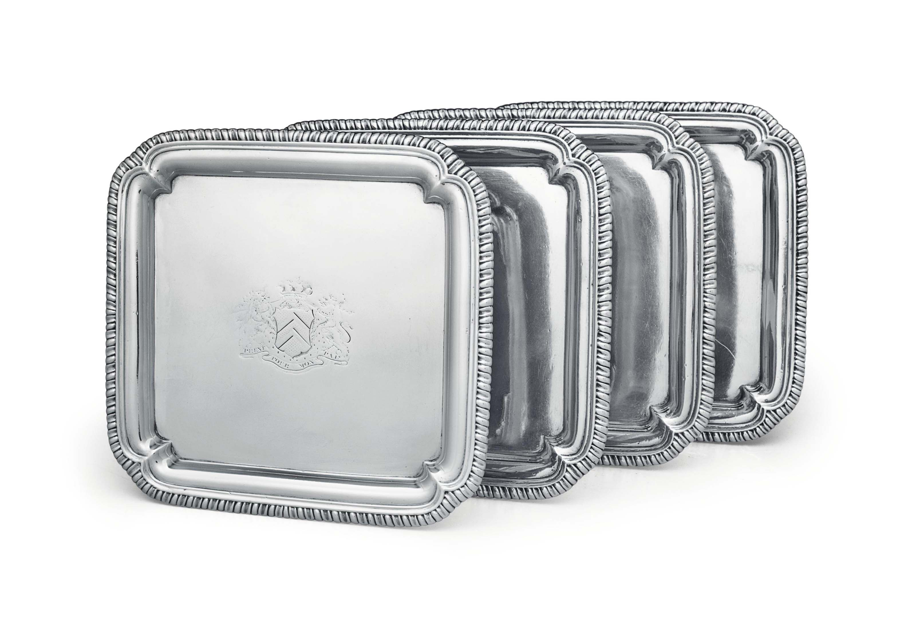 A SET OF FOUR GEORGE II SILVER WAITERS