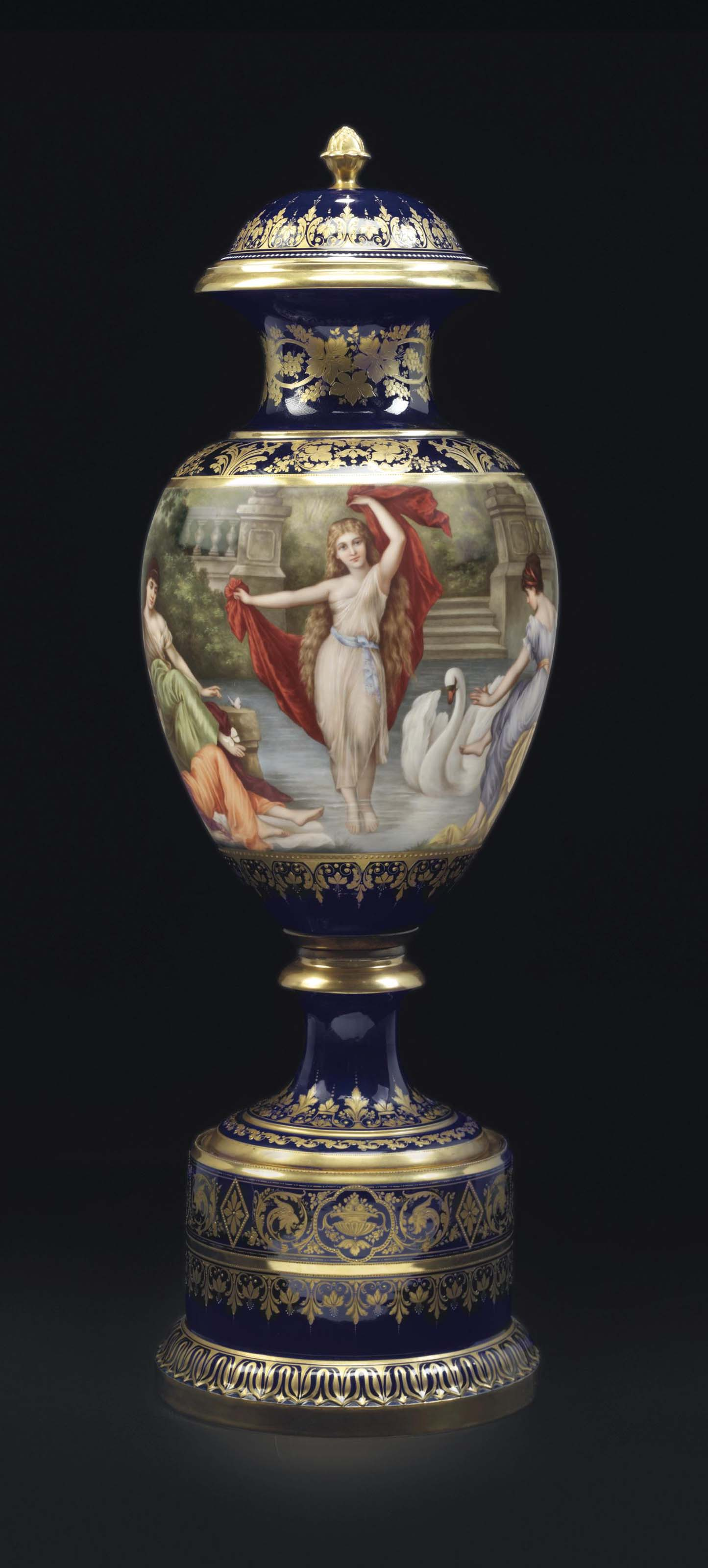A VIENNA STYLE PORCELAIN COBALT-BLUE GROUND VASE, COVER AND STAND