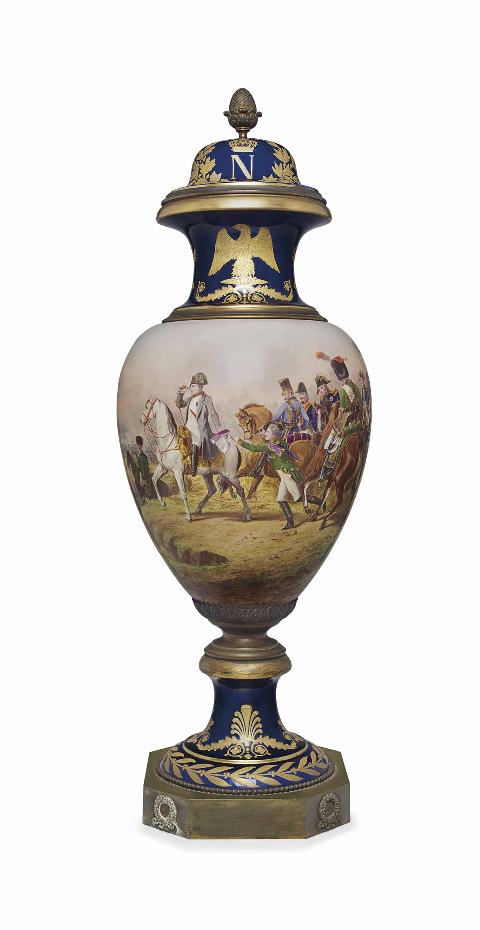 AN ORMOLU-MOUNTED SEVRES STYLE PORCELAIN NAPOLEONIC COBALT-BLUE GROUND VASE AND COVER