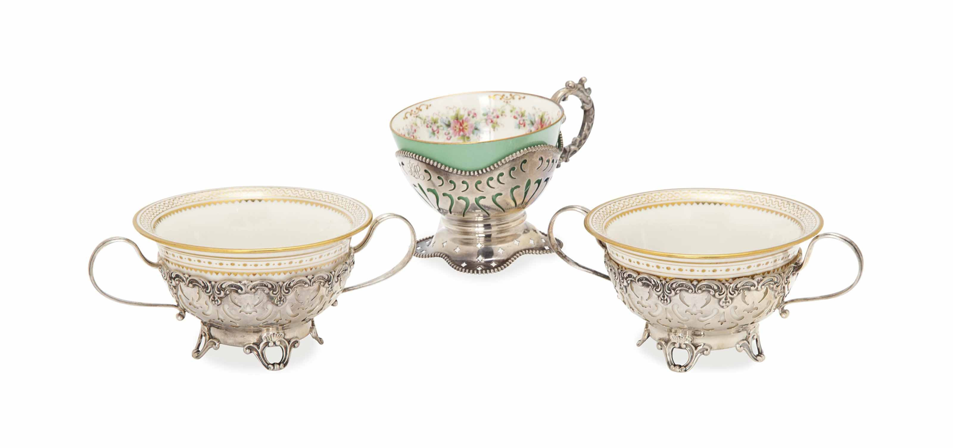 TWO SETS OF AMERICAN SILVER BREAKFAST CUPS WITH ASSOCIATED PORCELAIN LINERS,