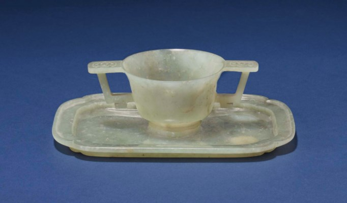 A GREYISH-GREEN JADE CUP AND T
