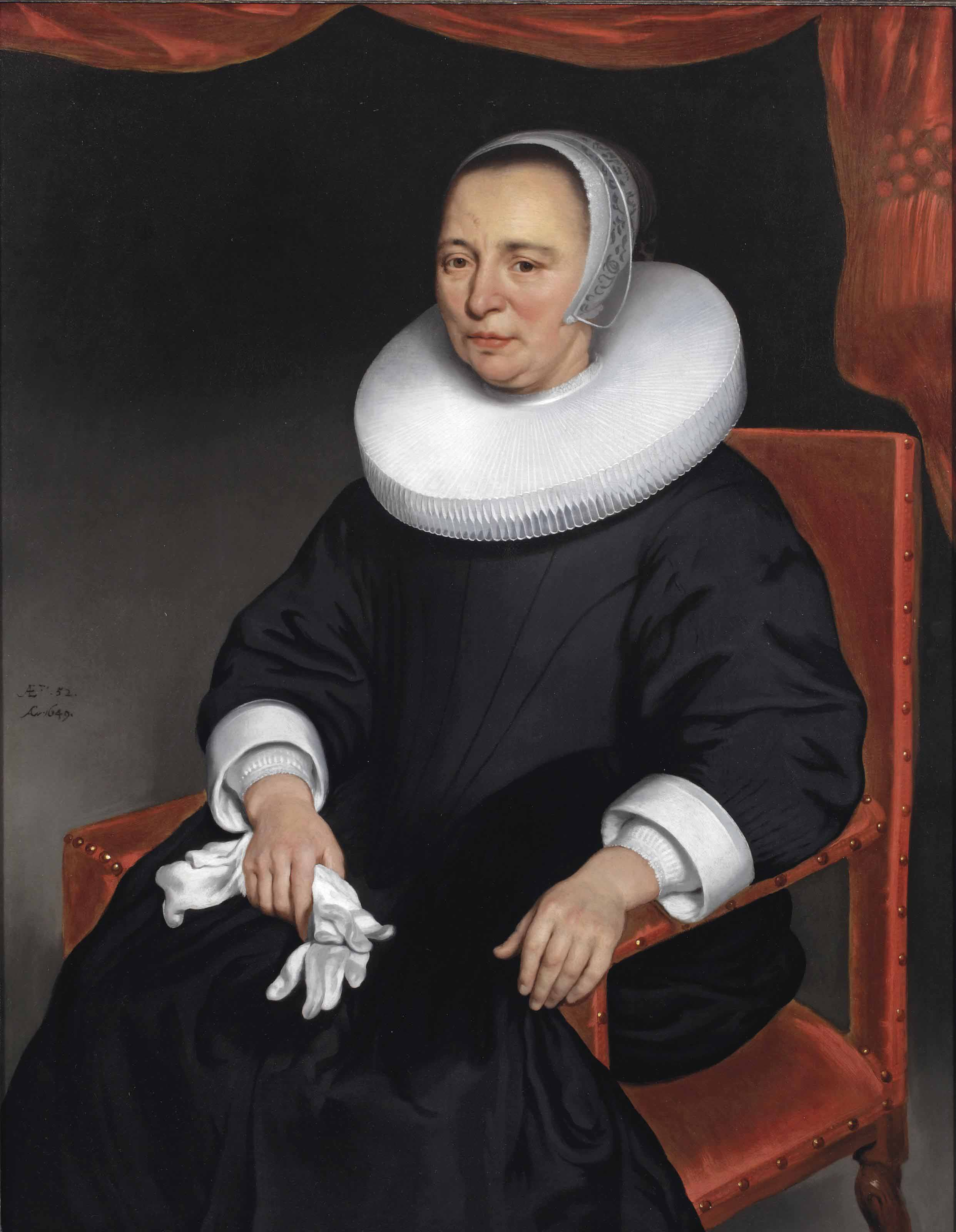 Portrait of a lady, three-quarter-length, in a black dress and ruff, holding a pair of gloves in her right hand, before a draped curtain
