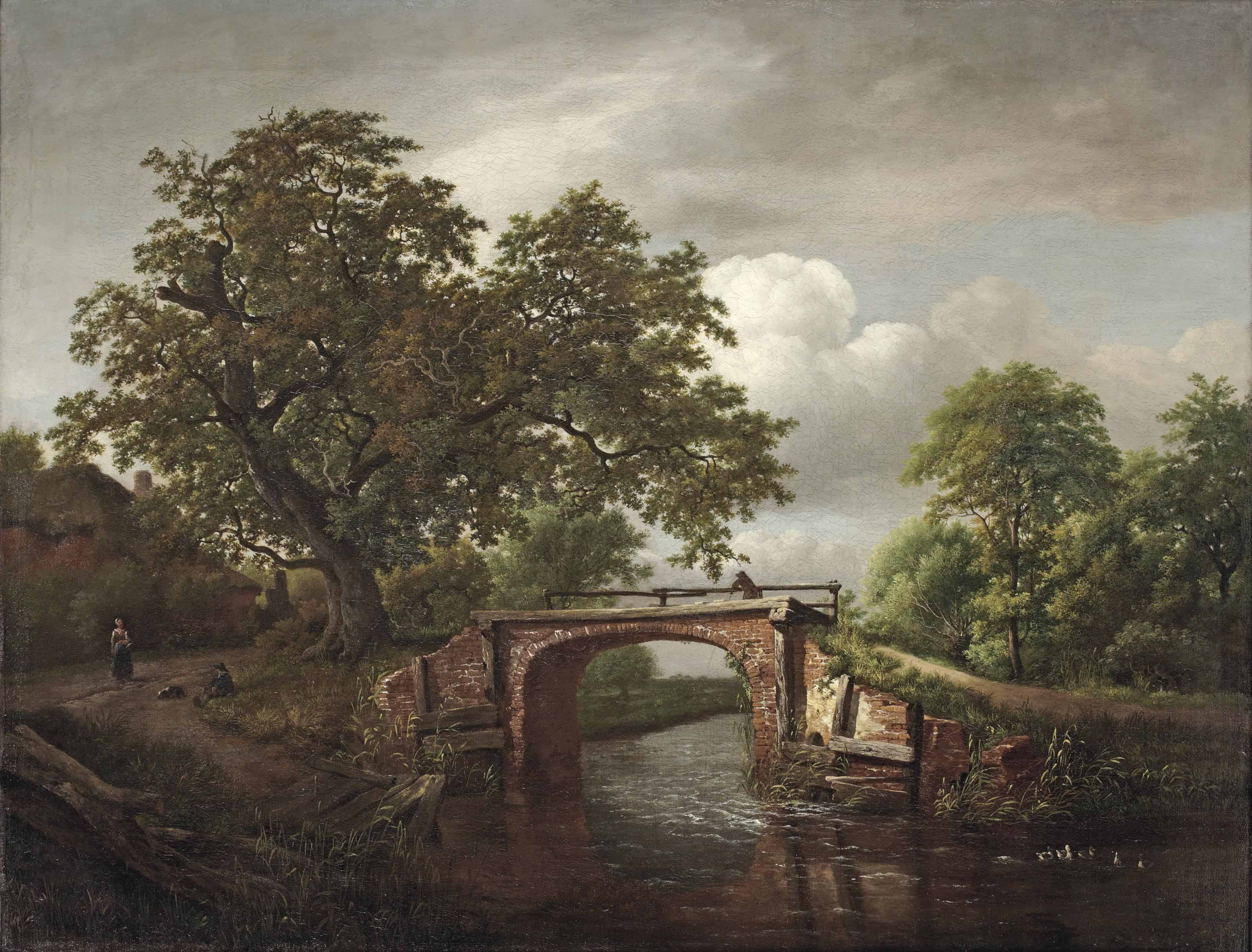 A wooded river landscape with a traveller crossing a stone bridge near an oak tree and a farm house