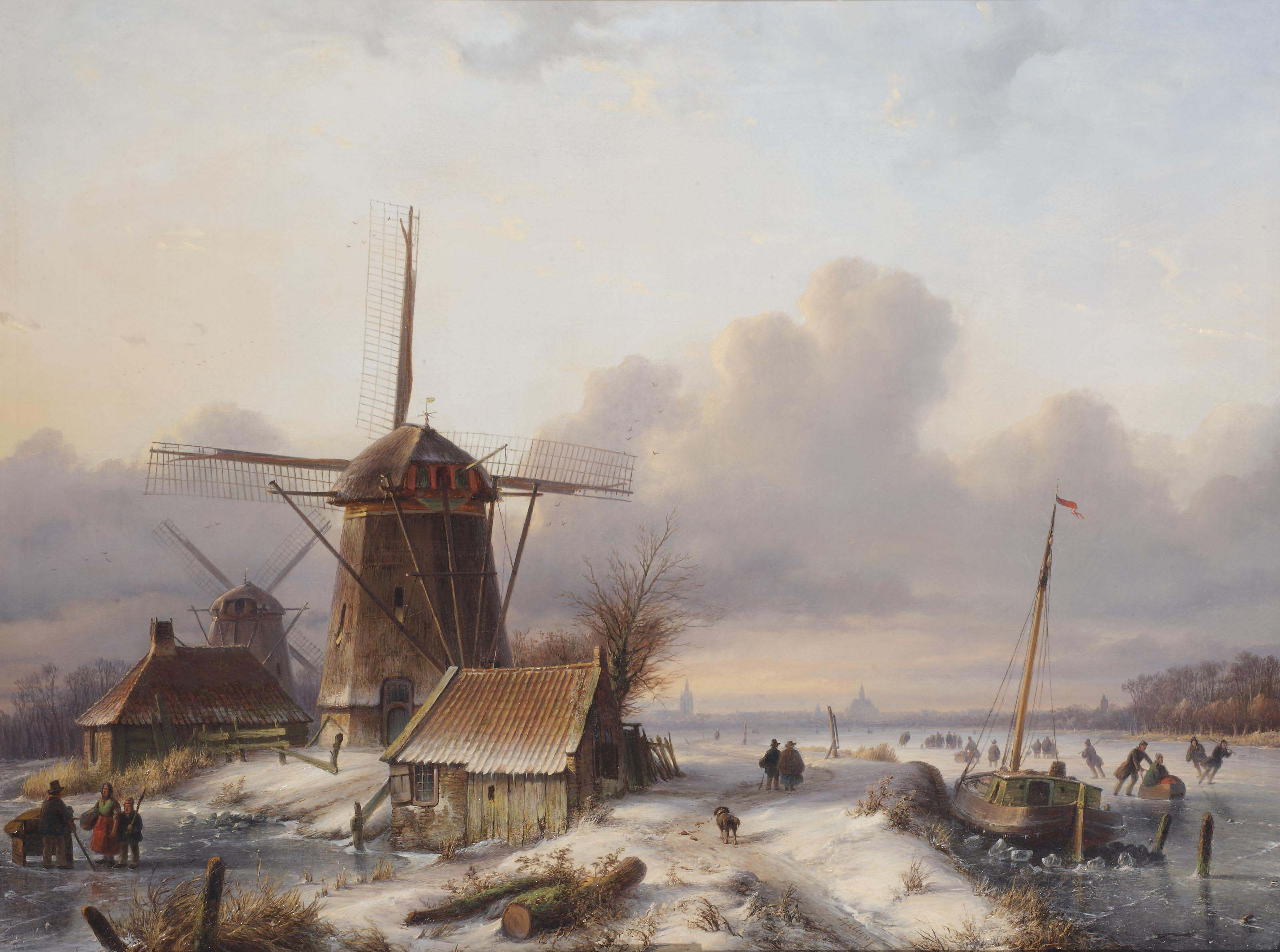 A winter scene with skaters near windmills