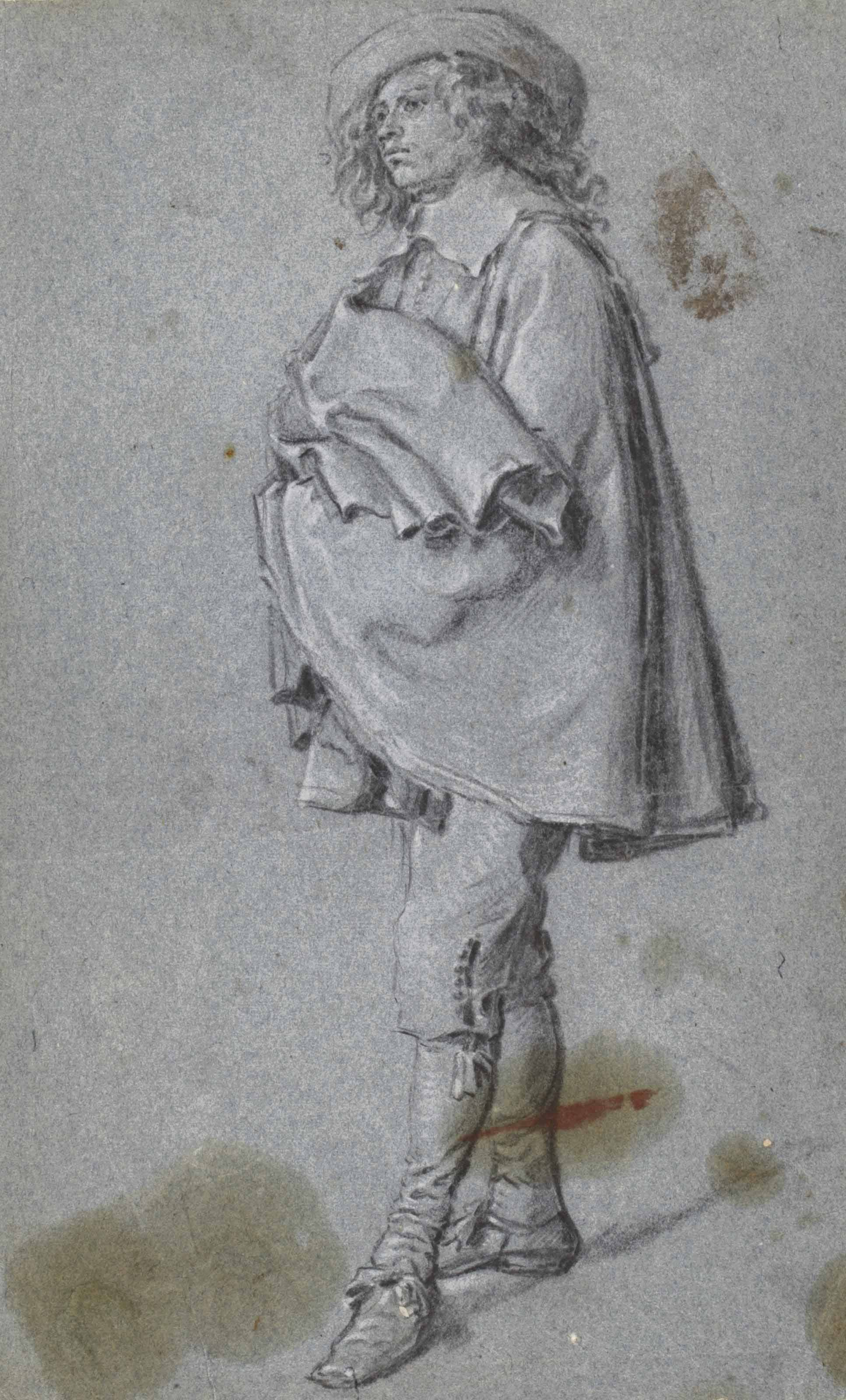 A standing young man, turned to the left