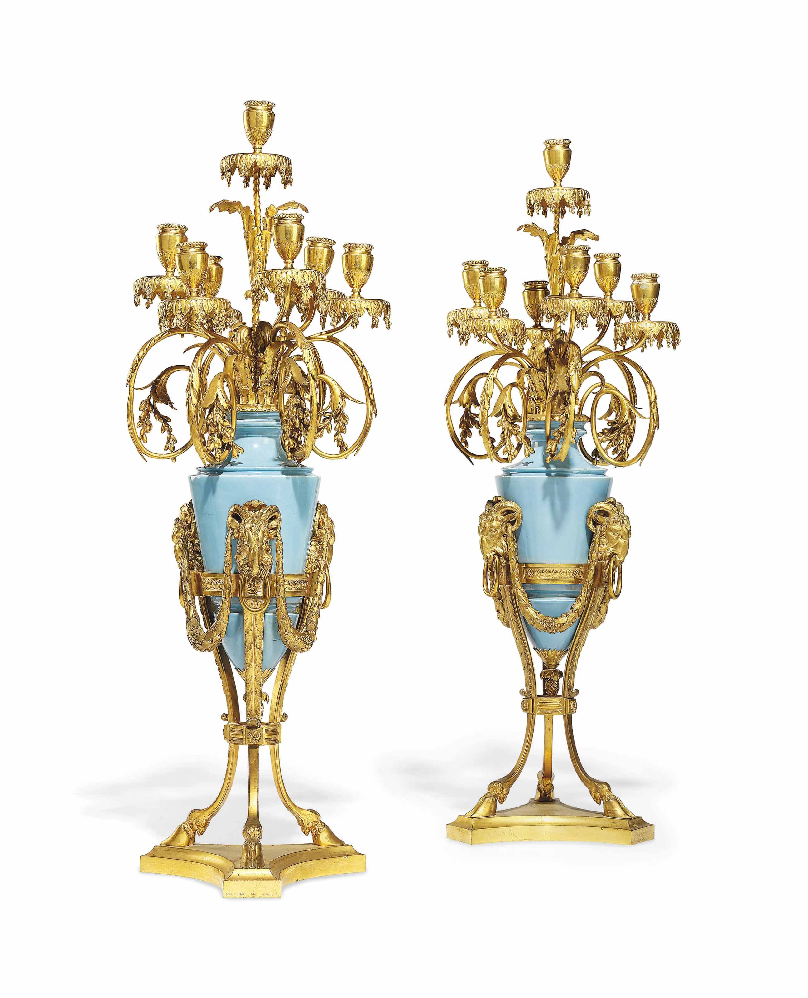 A PAIR FRENCH ORMOLU AND PALE BLUE GLAZED EARTHENWARE SIX-LIGHT CANDELABRA
