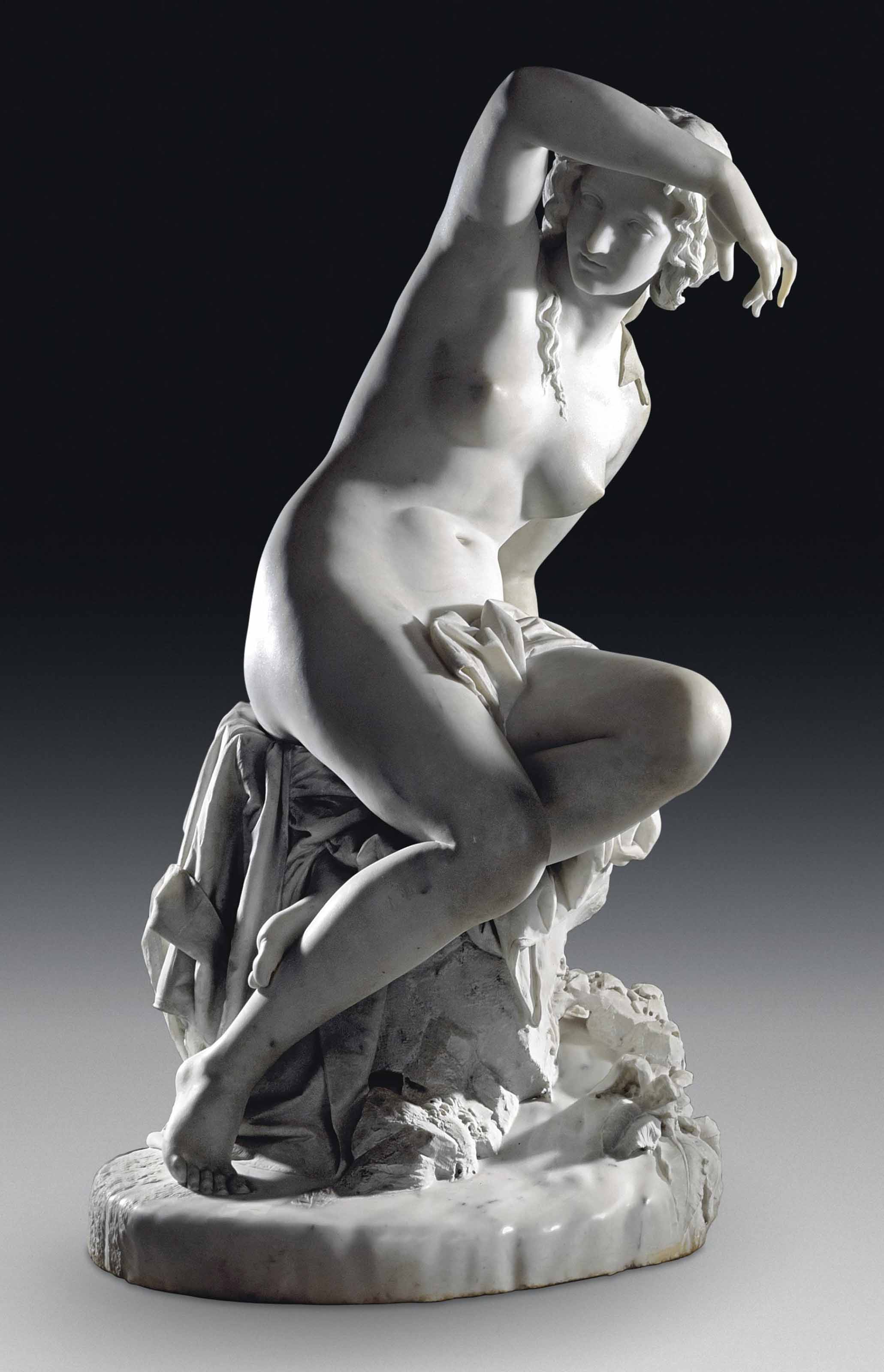 AN ITALIAN MARBLE FIGURE OF A FEMALE NYMPH, ENTITLED 'LA BAGNANTI' (BATHING WOMAN)