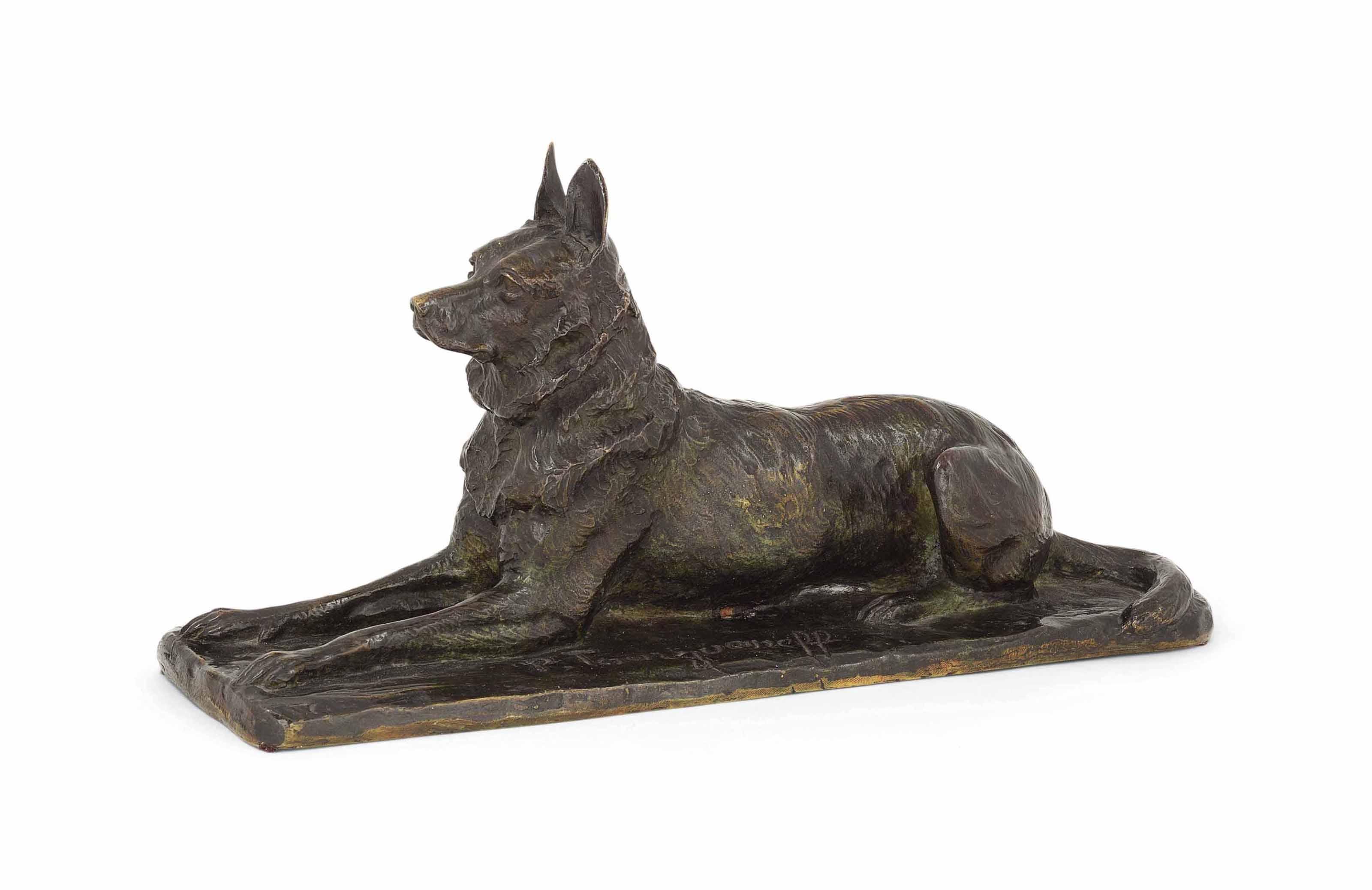 A BRONZE MODEL OF A DOG