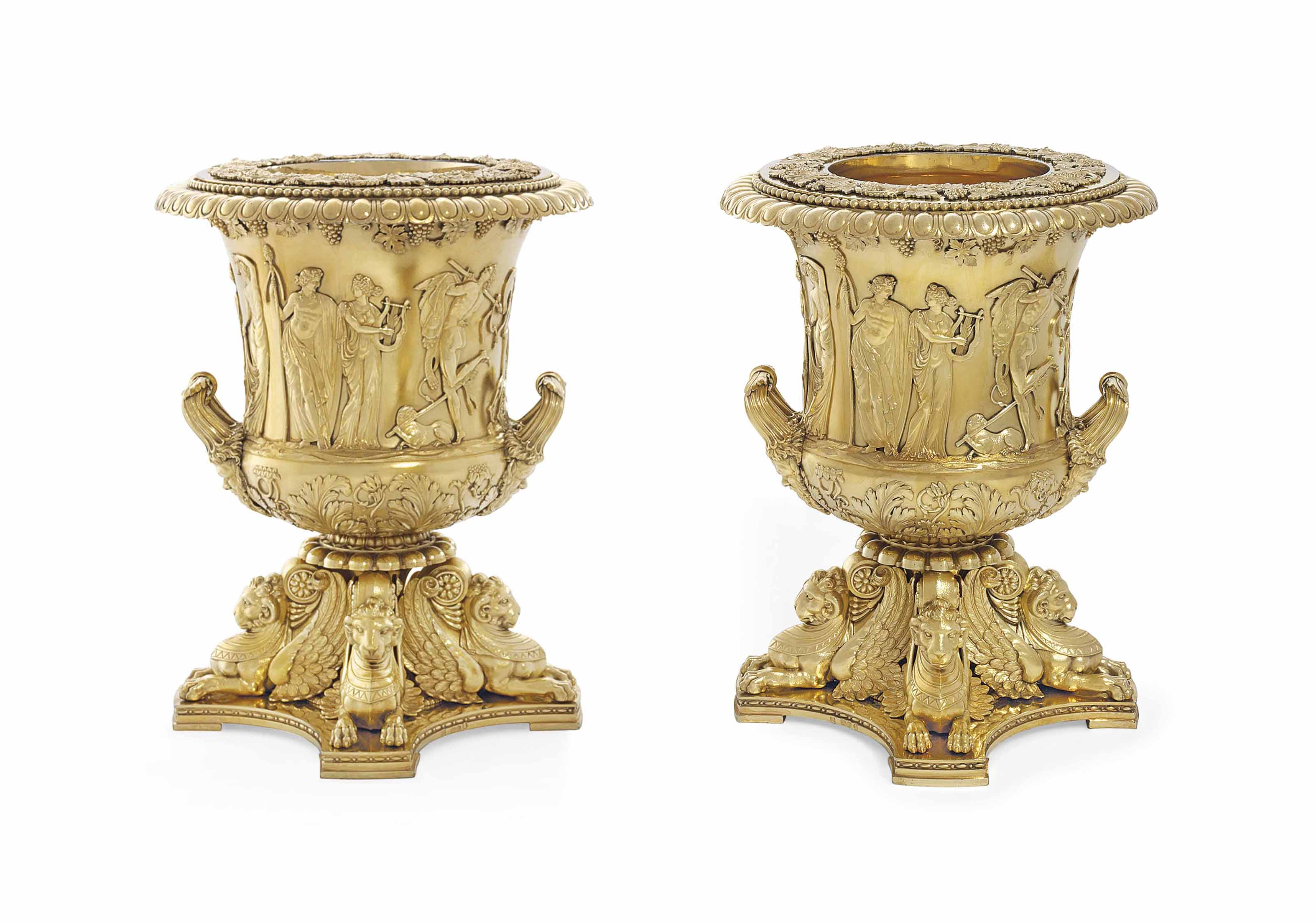 A PAIR OF GEORGE III SILVER-GILT WINE-COOLERS, COLLARS AND LINERS
