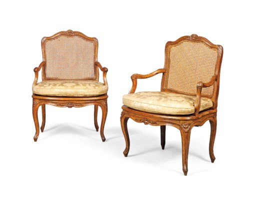 A PAIR OF LOUIS XV WALNUT CANE