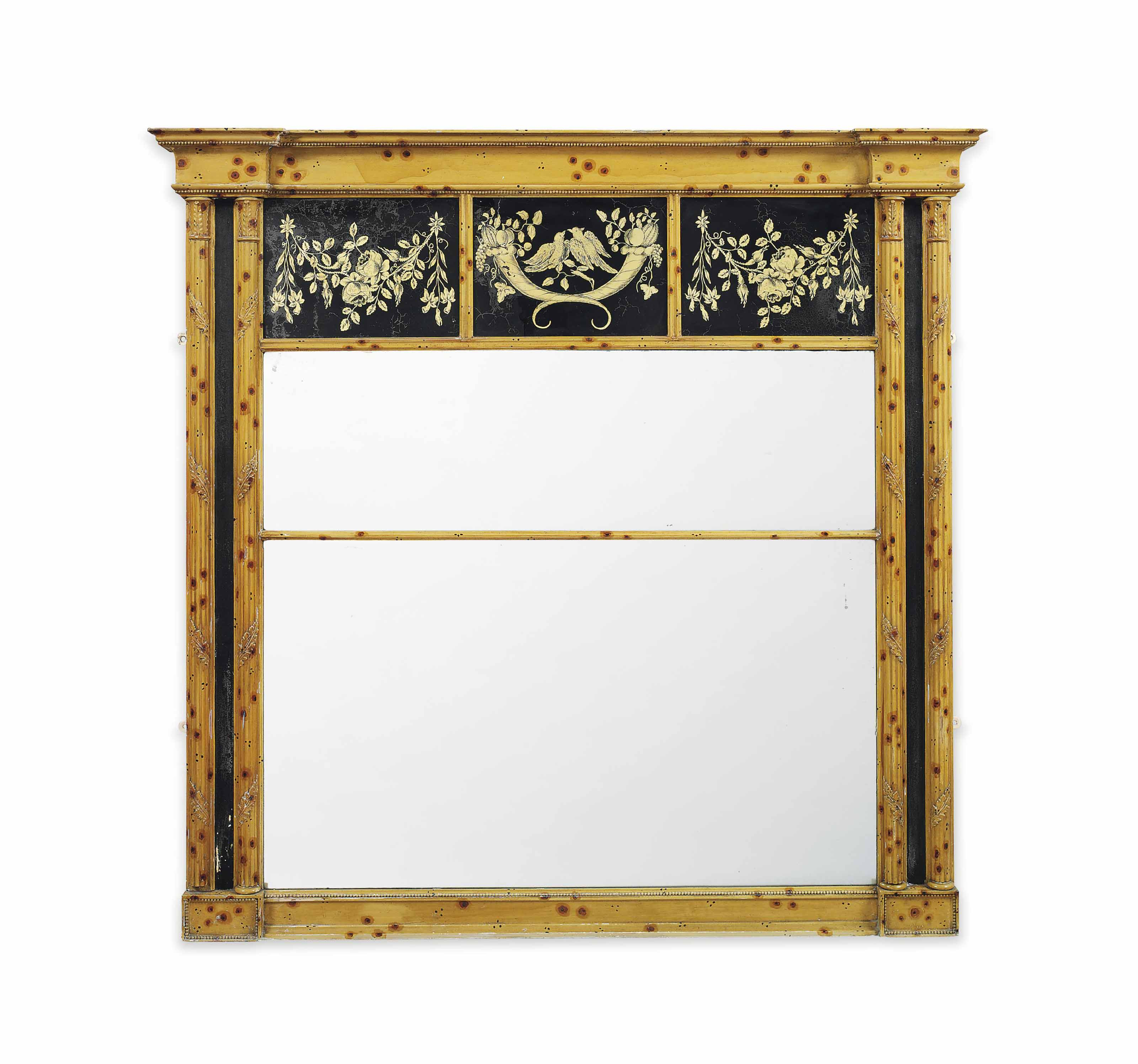 A REGENCY SIMULATED BAMBOO AND VERRE EGLOMISE OVERMANTEL MIRROR