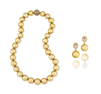 A GOLDEN CULTURED PEARL AND CO