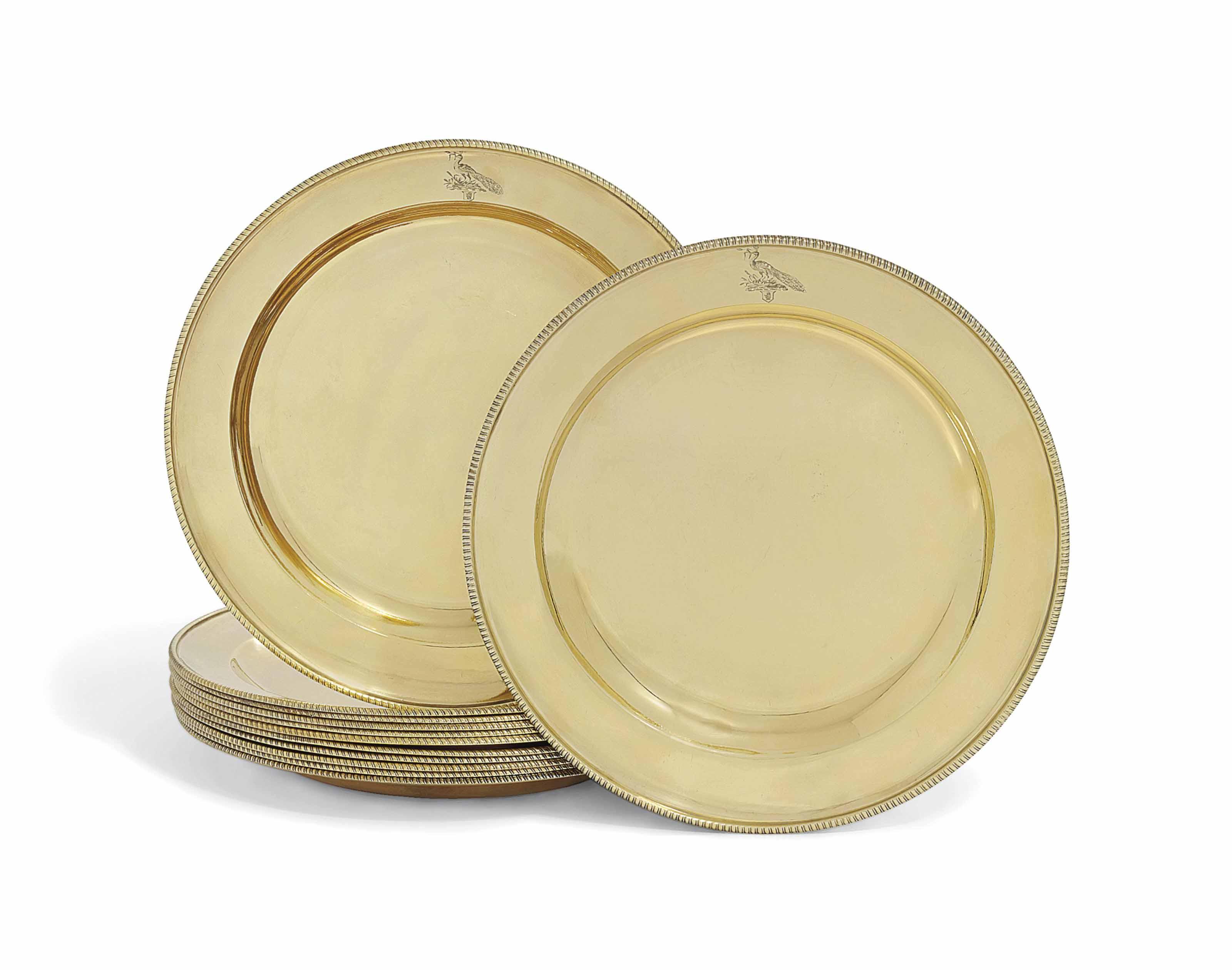 TWELVE GEORGE III SILVER-GILT DINNER-PLATES
