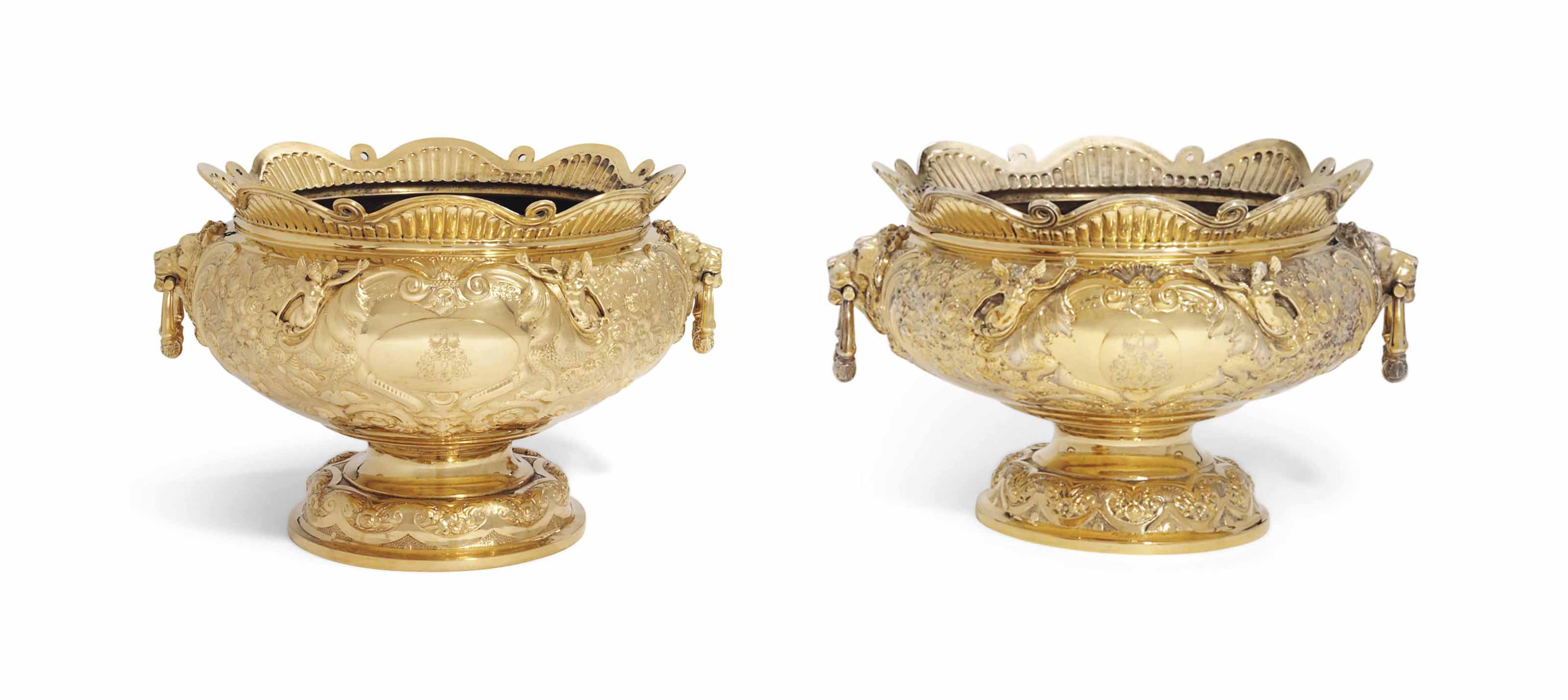 TWO GRADUATED VICTORIAN AND EDWARD VII SILVER-GILT PUNCH-BOWLS