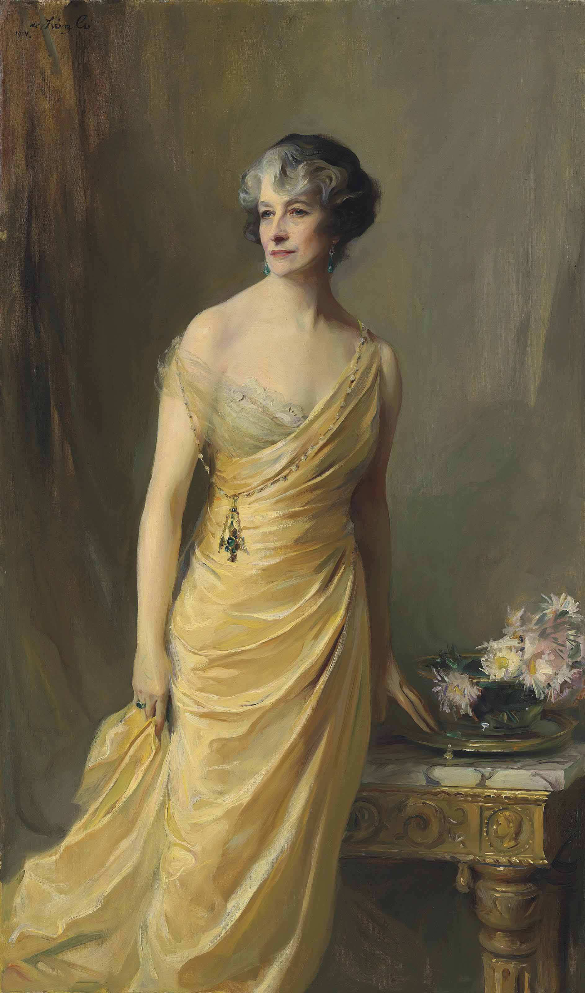 Lady Ludlow, née Alice Sedgwick Mankiewicz (previously Lady Wernher), standing, three-quarter-length, in a yellow evening dress