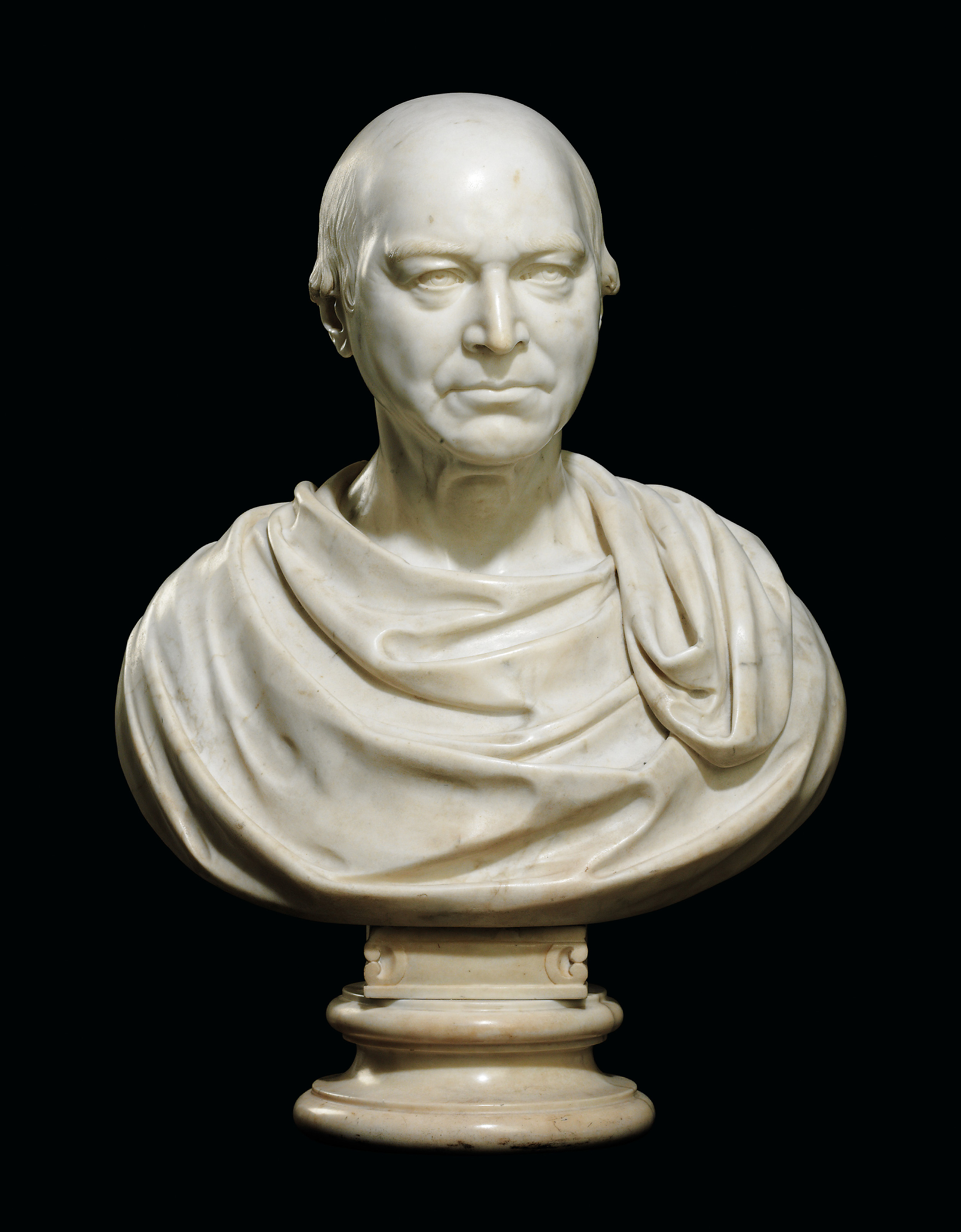 A MARBLE BUST OF A GENTLEMAN