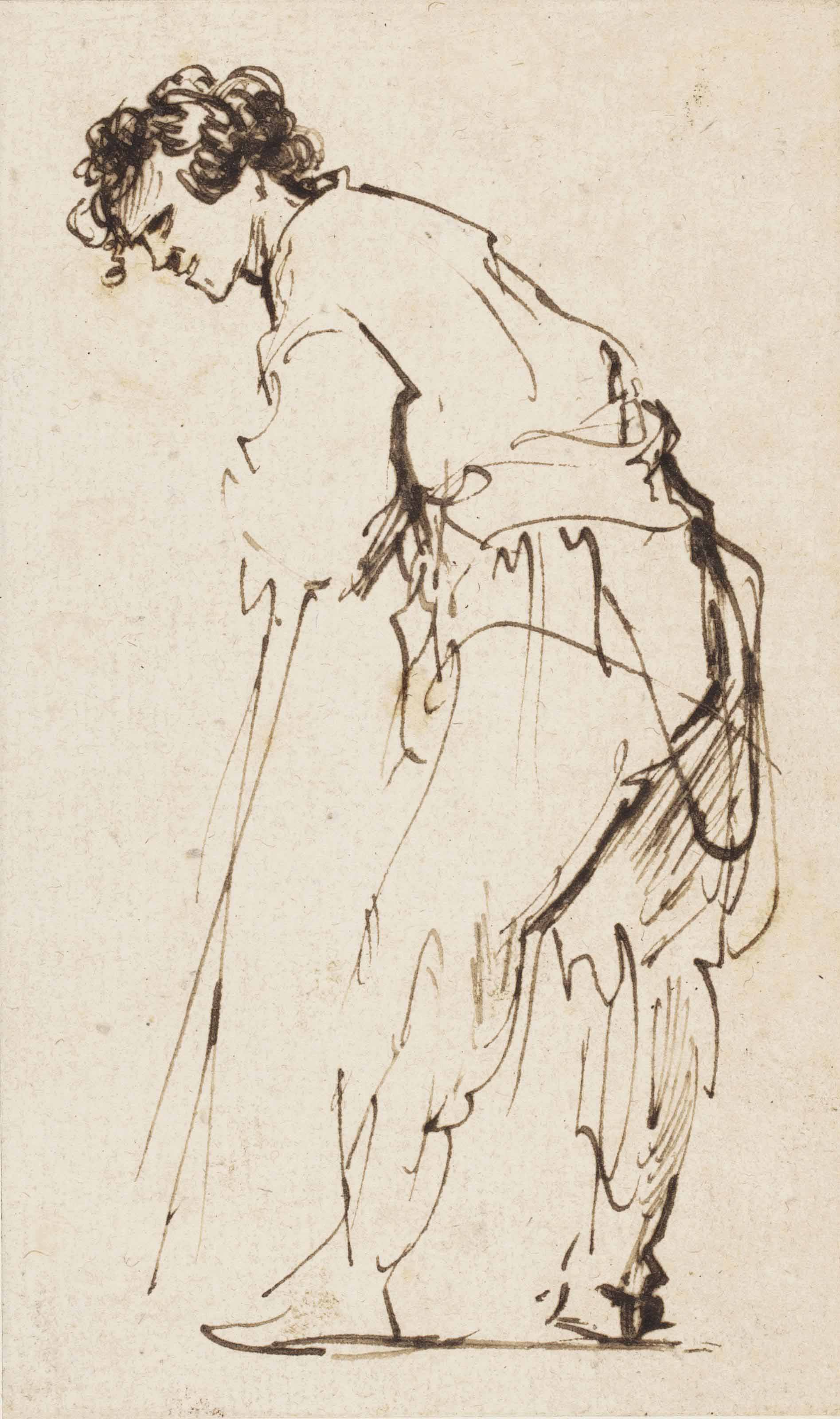 A young man leaning on a stick