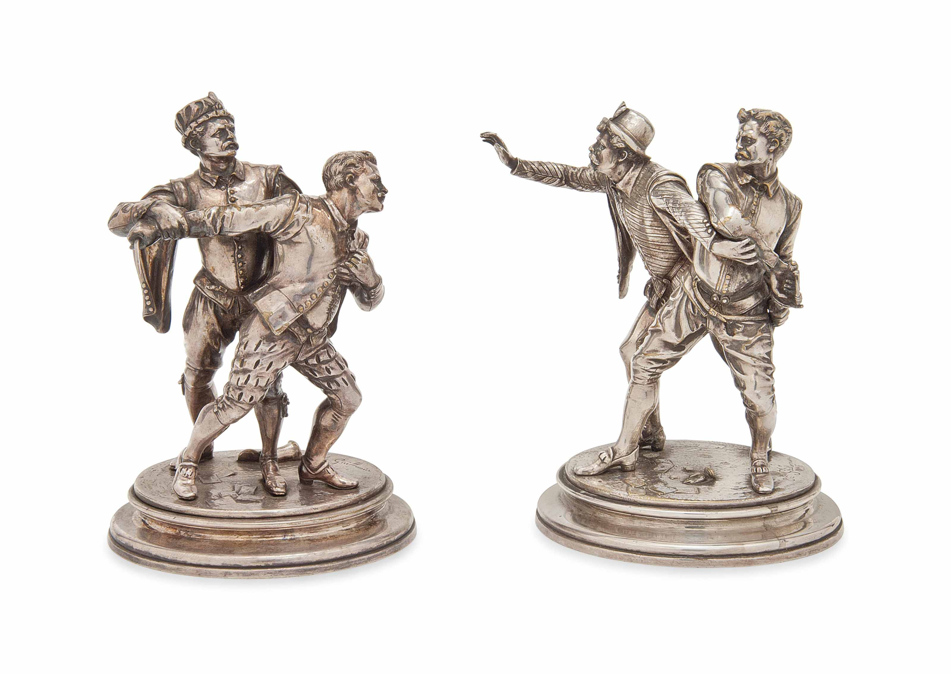 A PAIR OF FRENCH SILVERED BRONZE FIGURAL GROUPS