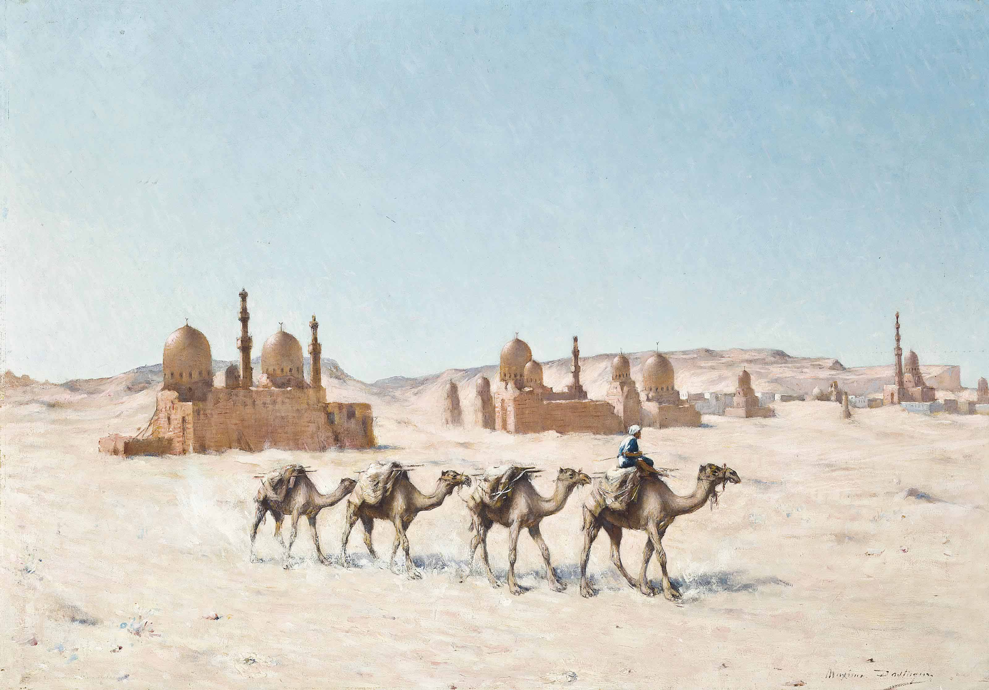 A camel train before a town in the desert