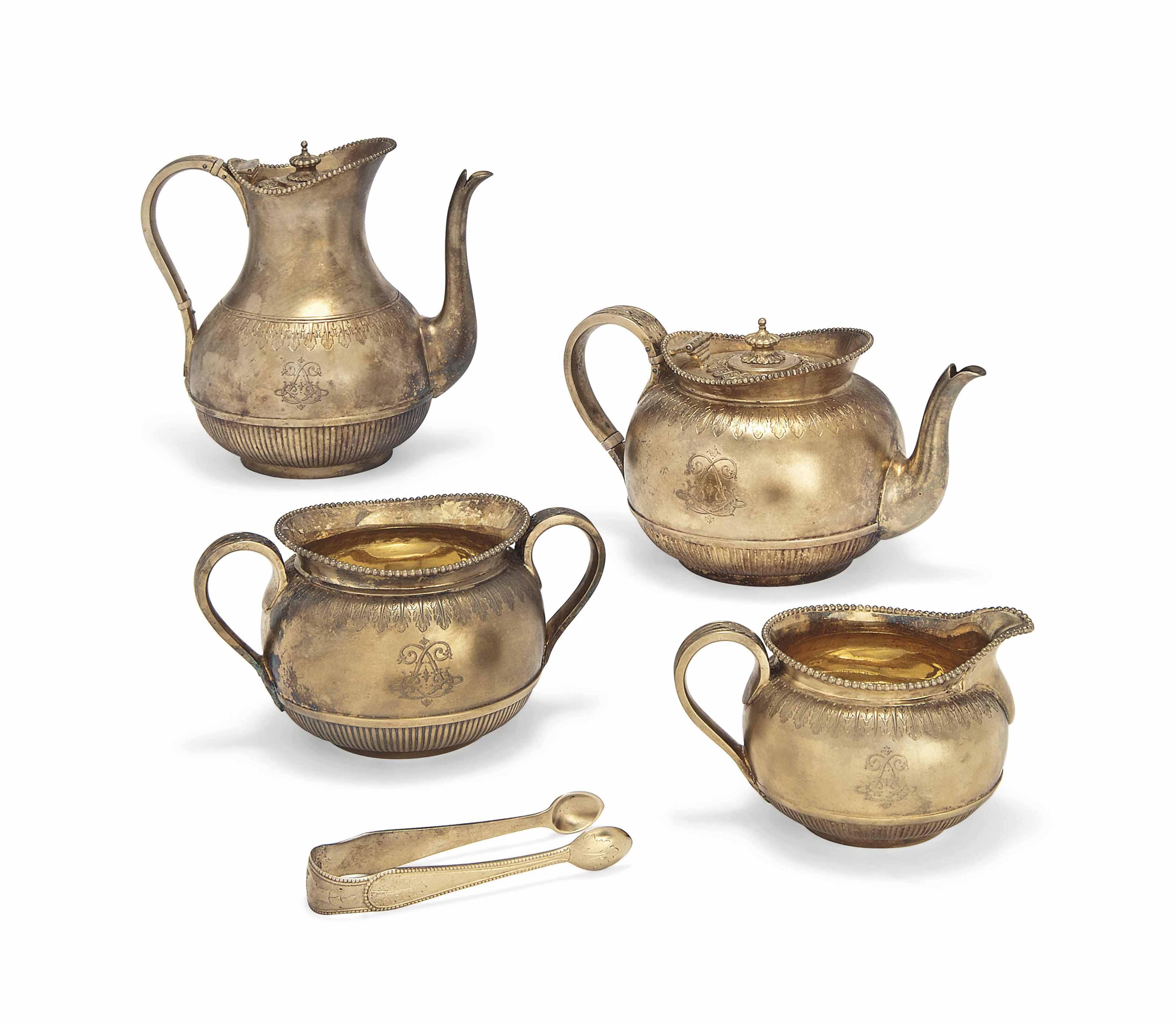 A VICTORIAN FOUR-PIECE SILVER-GILT BACHELOR'S TEA AND COFFEE SET
