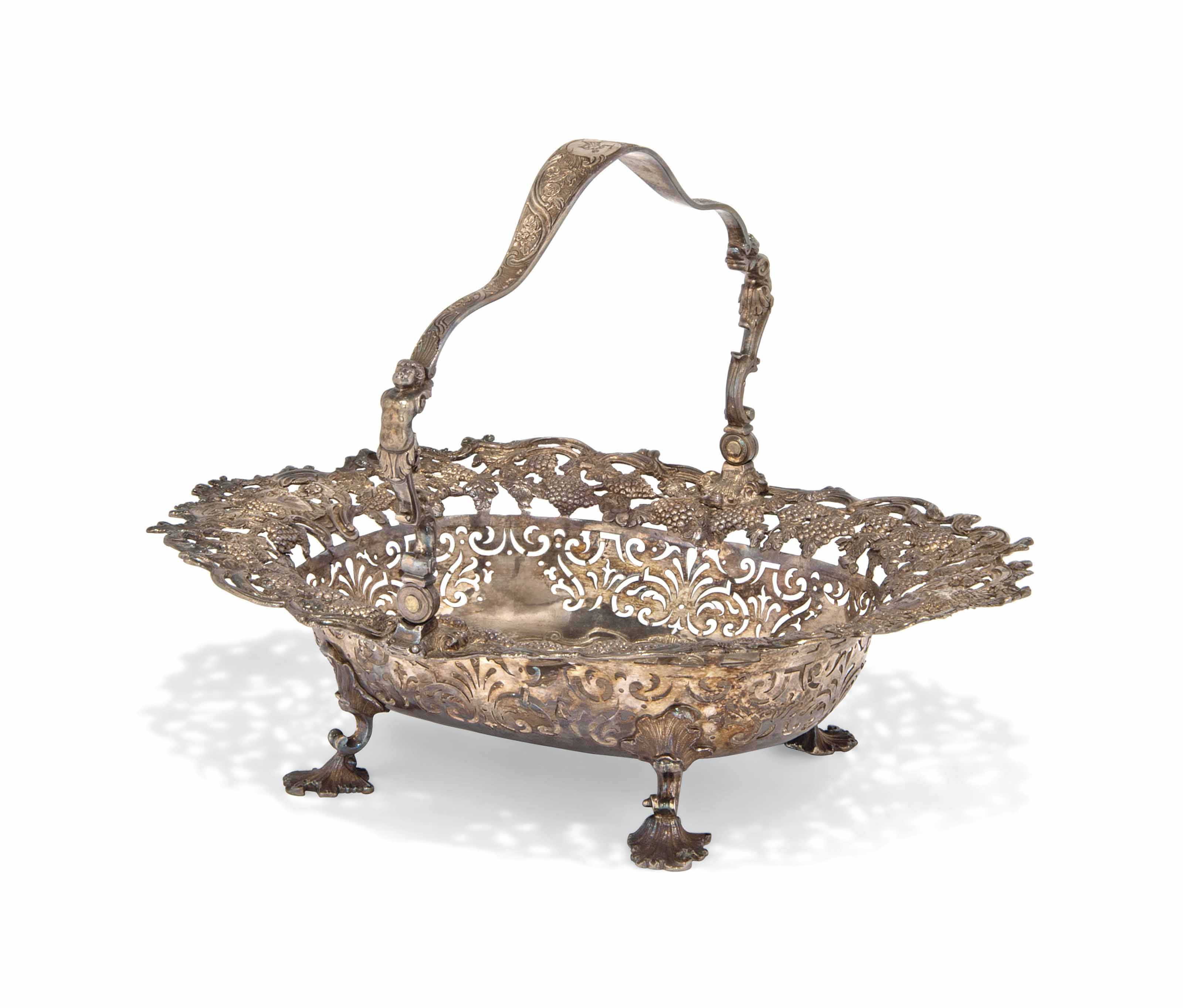 A GEORGE II SILVER CAKE BASKET WITH SWING HANDLE