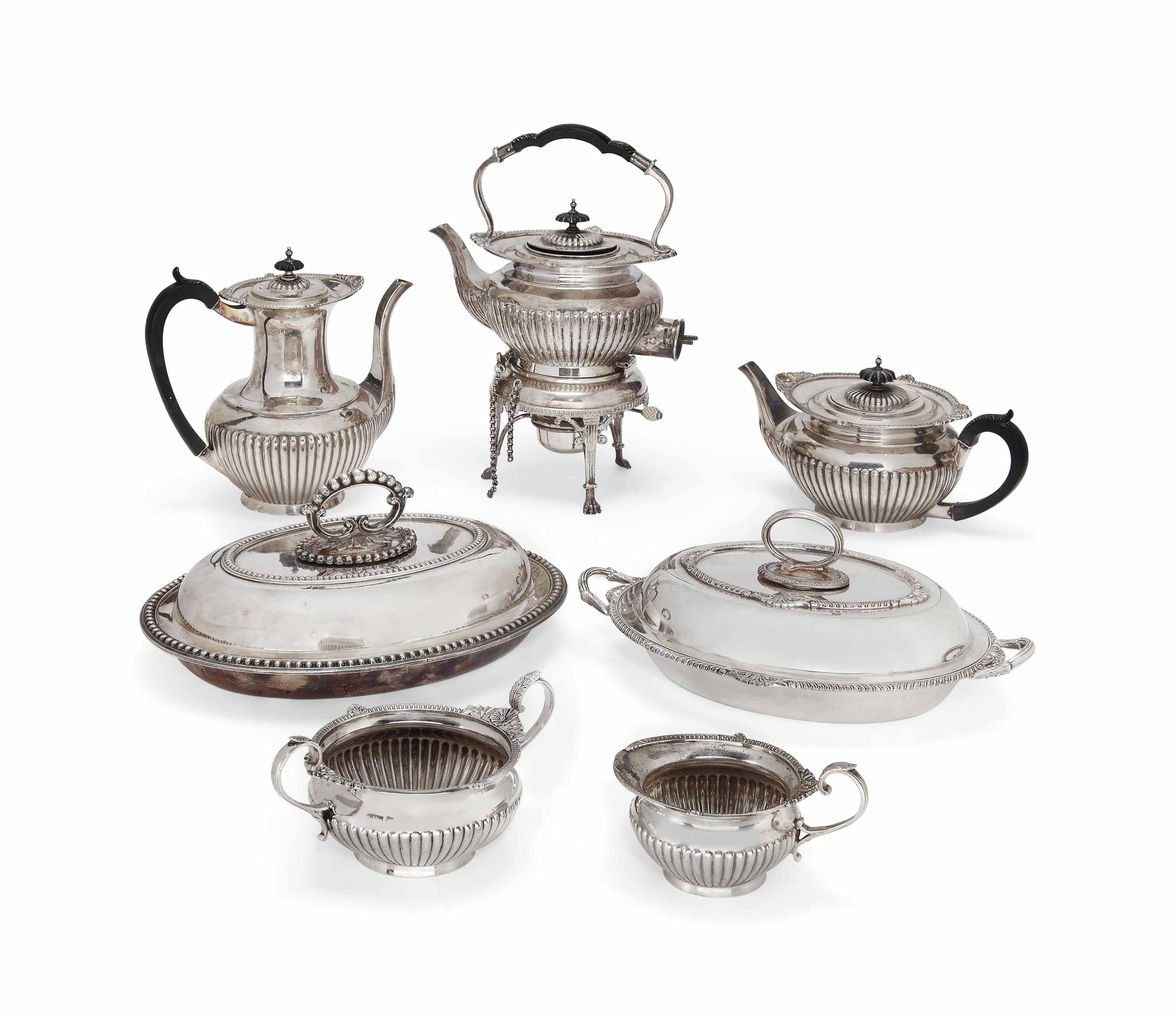 AN EDWARDIAN SILVER FIVE-PIECE TEA AND COFFEE SET OF CAPE PATTERN