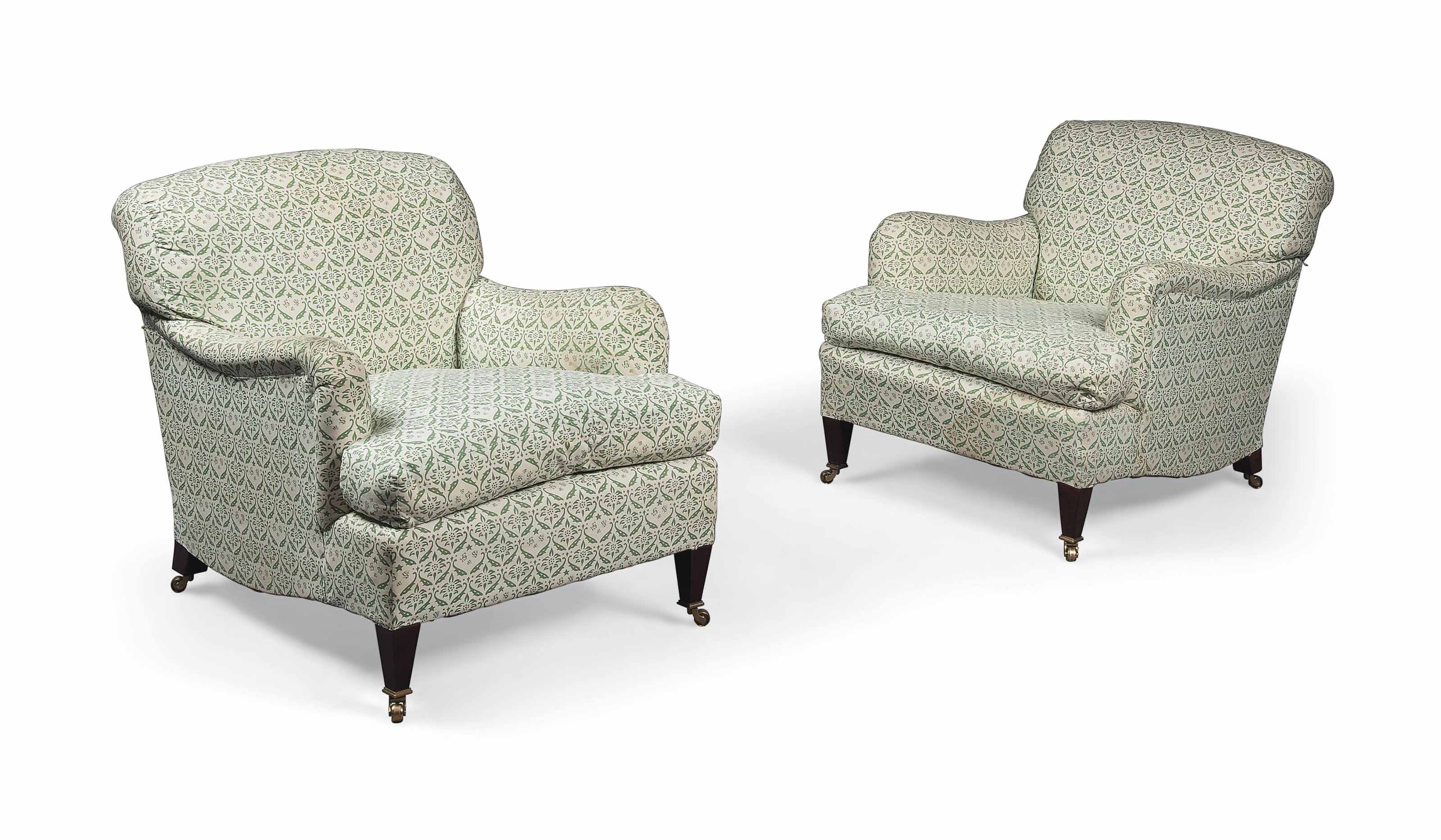 A PAIR OF BEECH EASY ARMCHAIRS