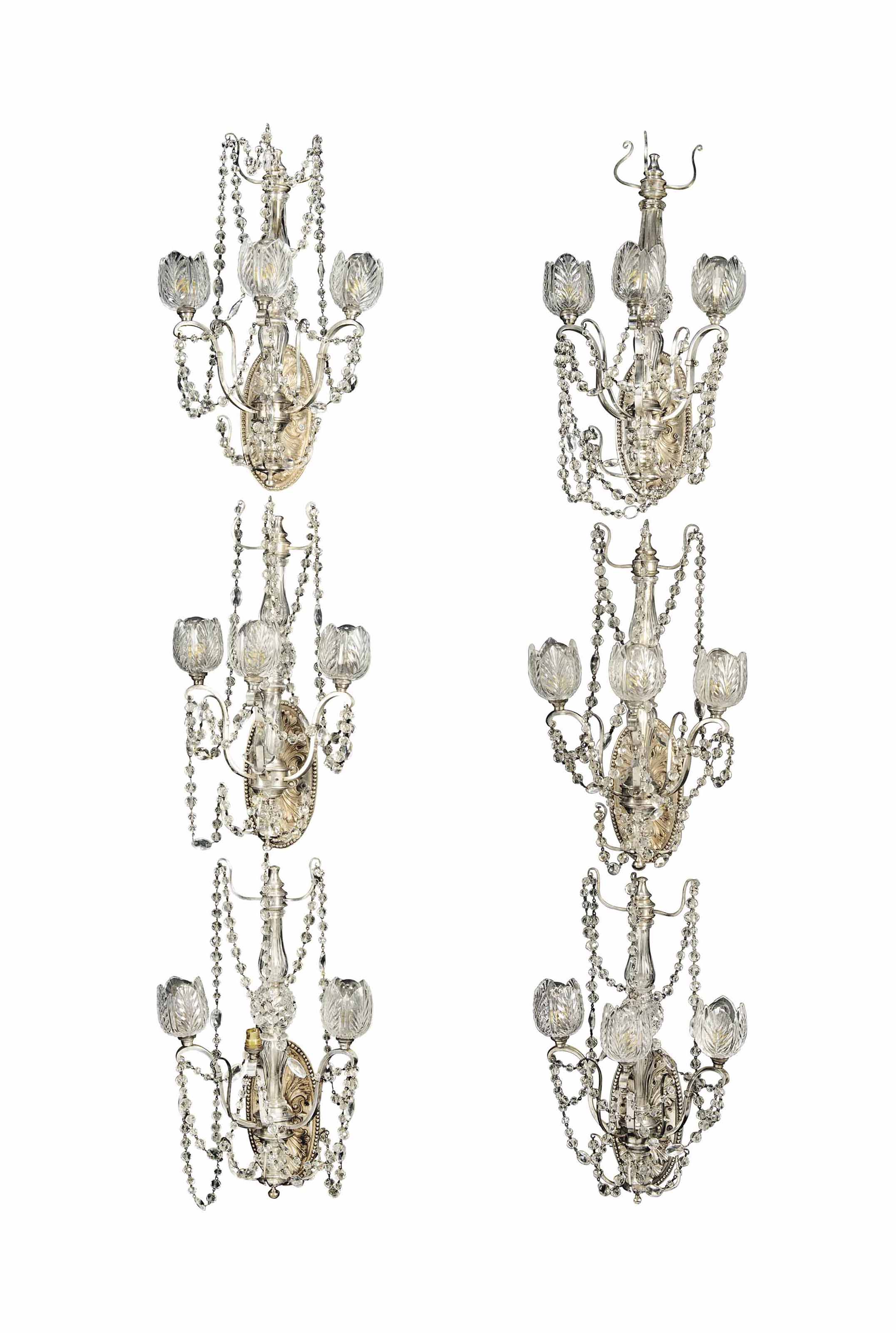 A SET OF SIX EDWARDIAN SILVERED-BRONZE AND GLASS THREE-LIGHT WALL-APPLIQUES