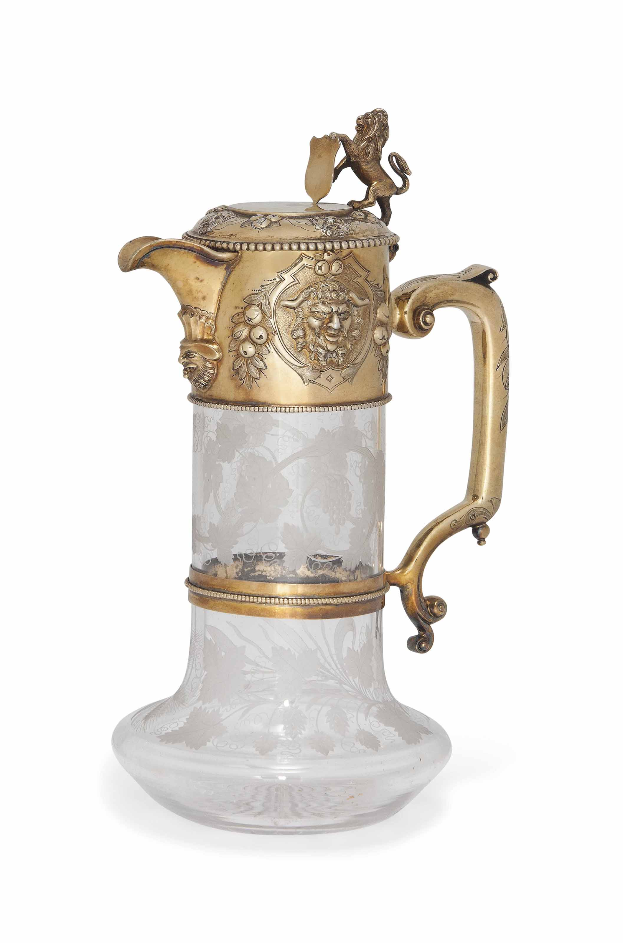 A VICTORIAN SILVER-GILT MOUNTED GLASS CLARET JUG