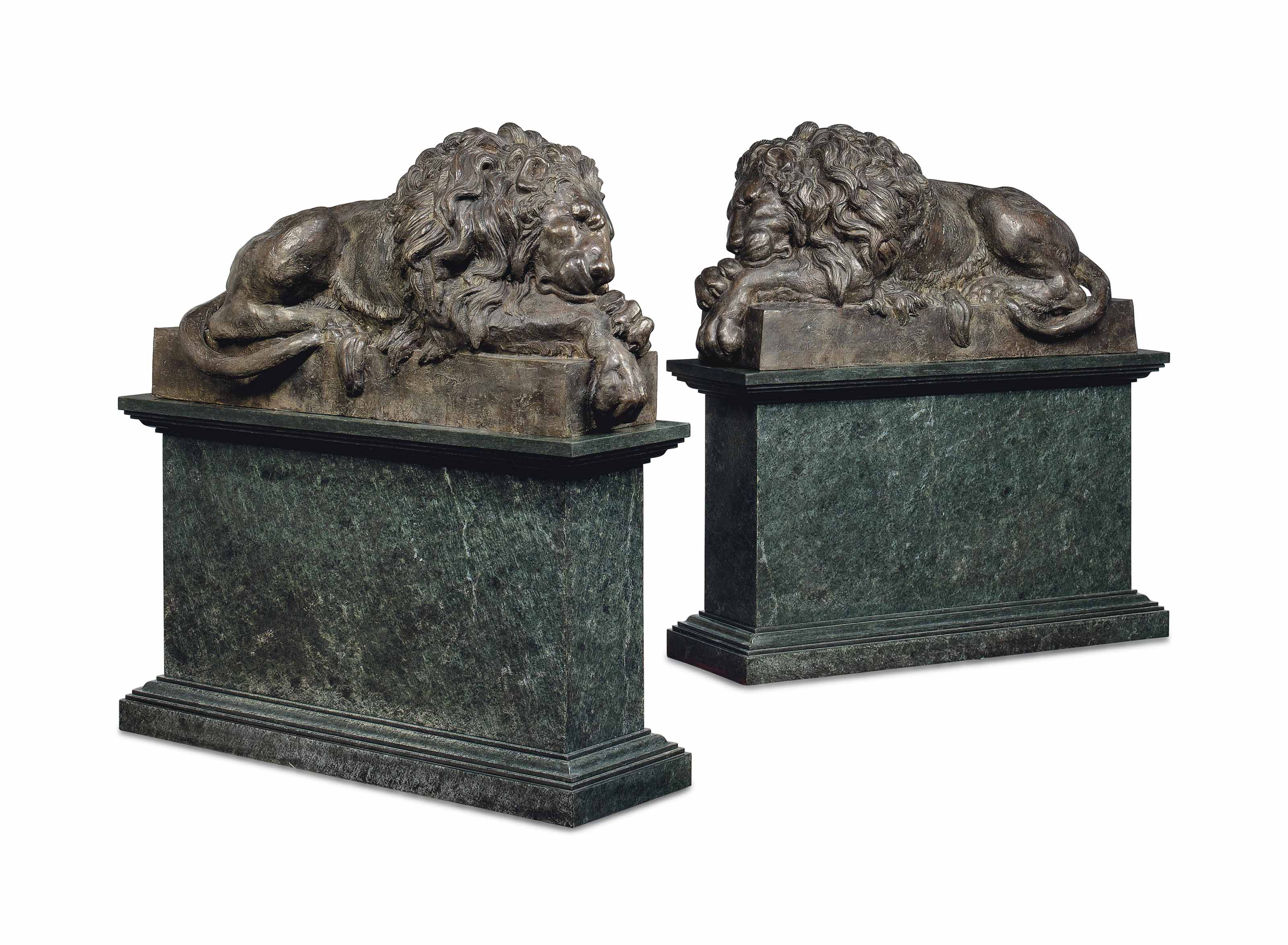 A LARGE PAIR OF BRONZE MODELS OF LIONS