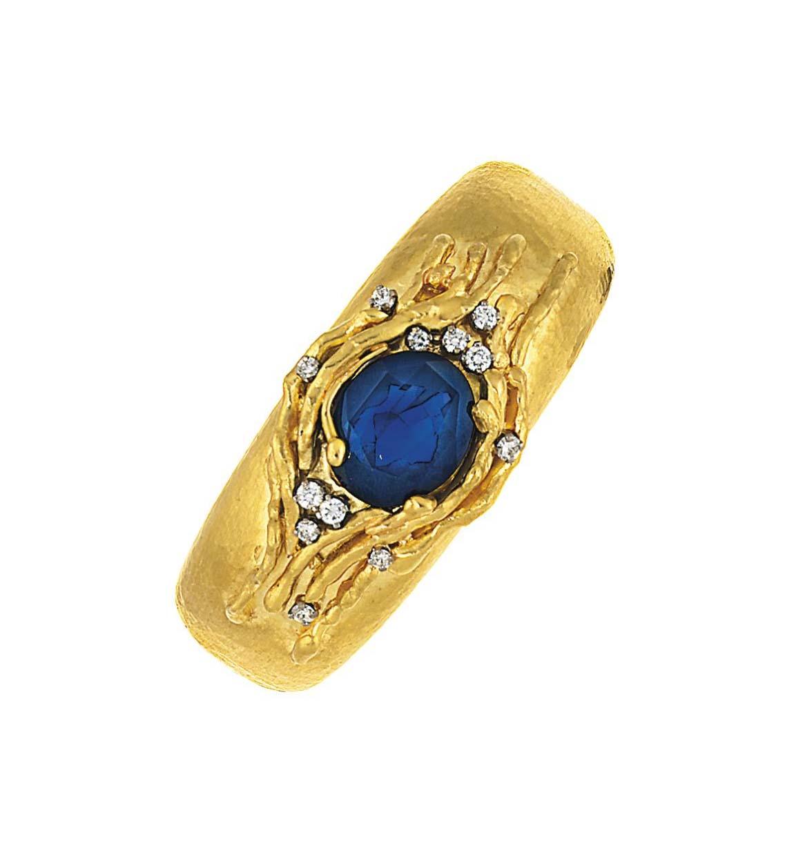 A sapphire and diamond-set bangle, by Grima
