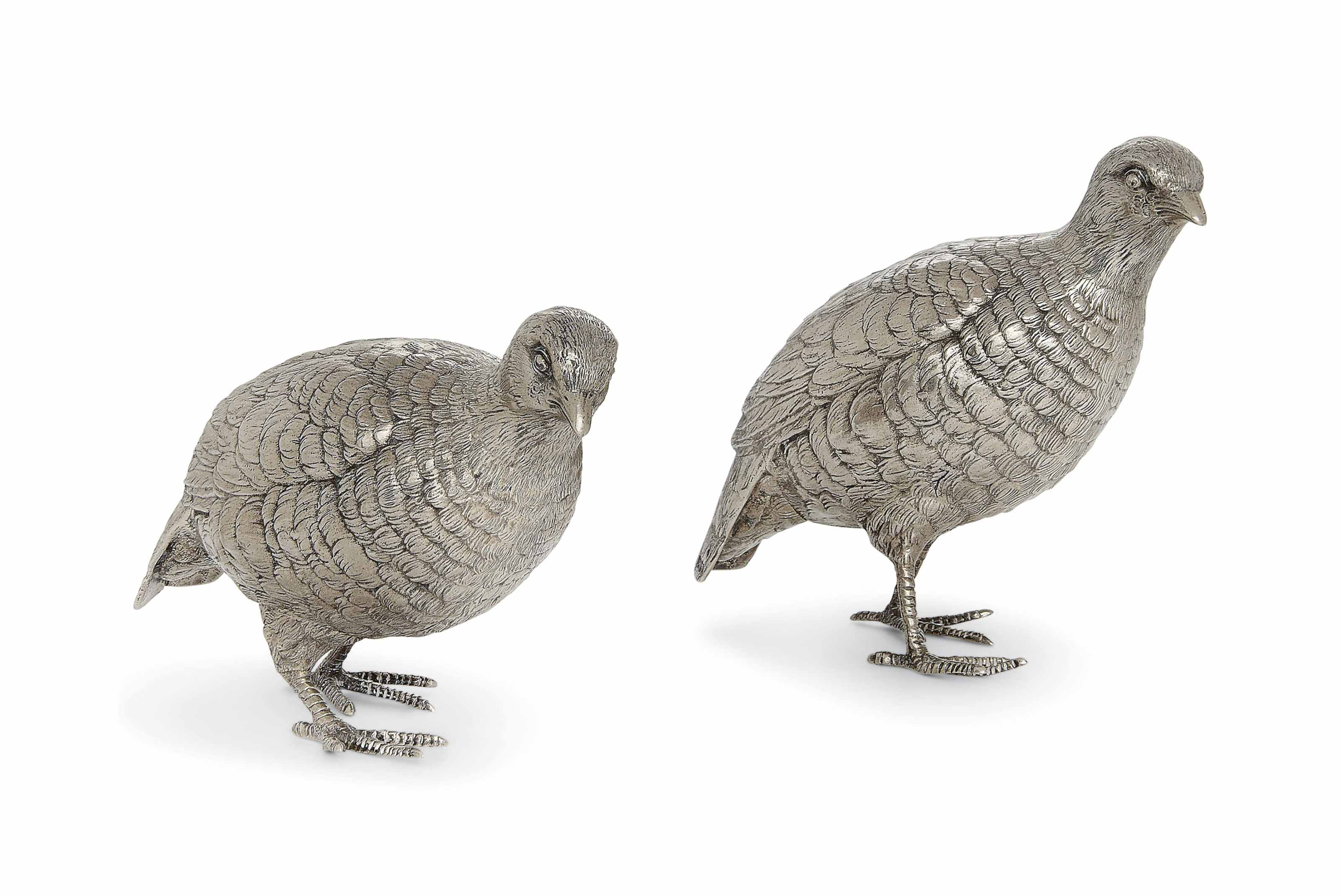 A PAIR OF MODERN SILVER CAST TABLE ORNAMENTS MODELLED AS GROUSE